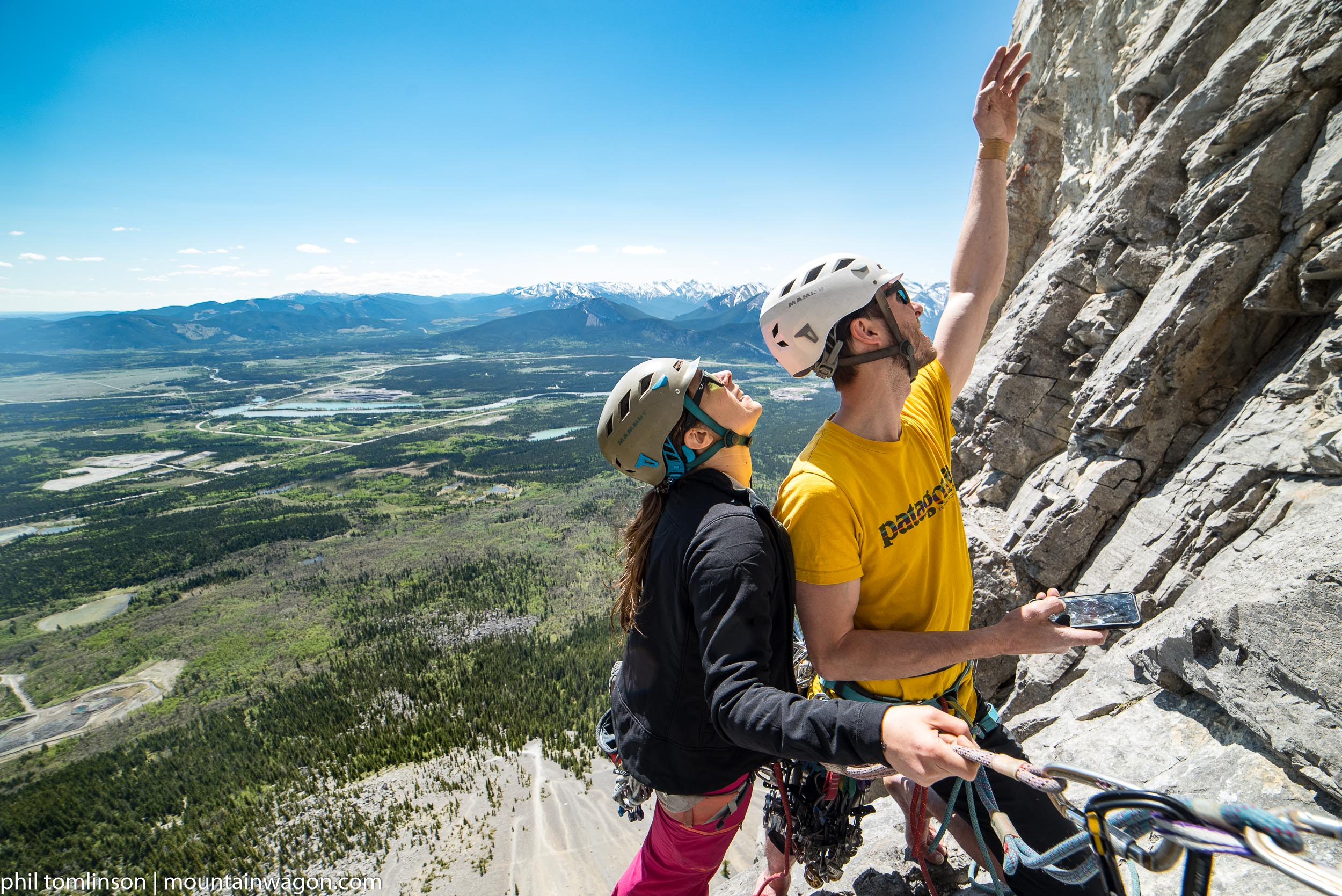 The only way this could have been a more classic Yamnuska photo is if they were using the guidebook instead of a cell phone to figure out where the hell the route went