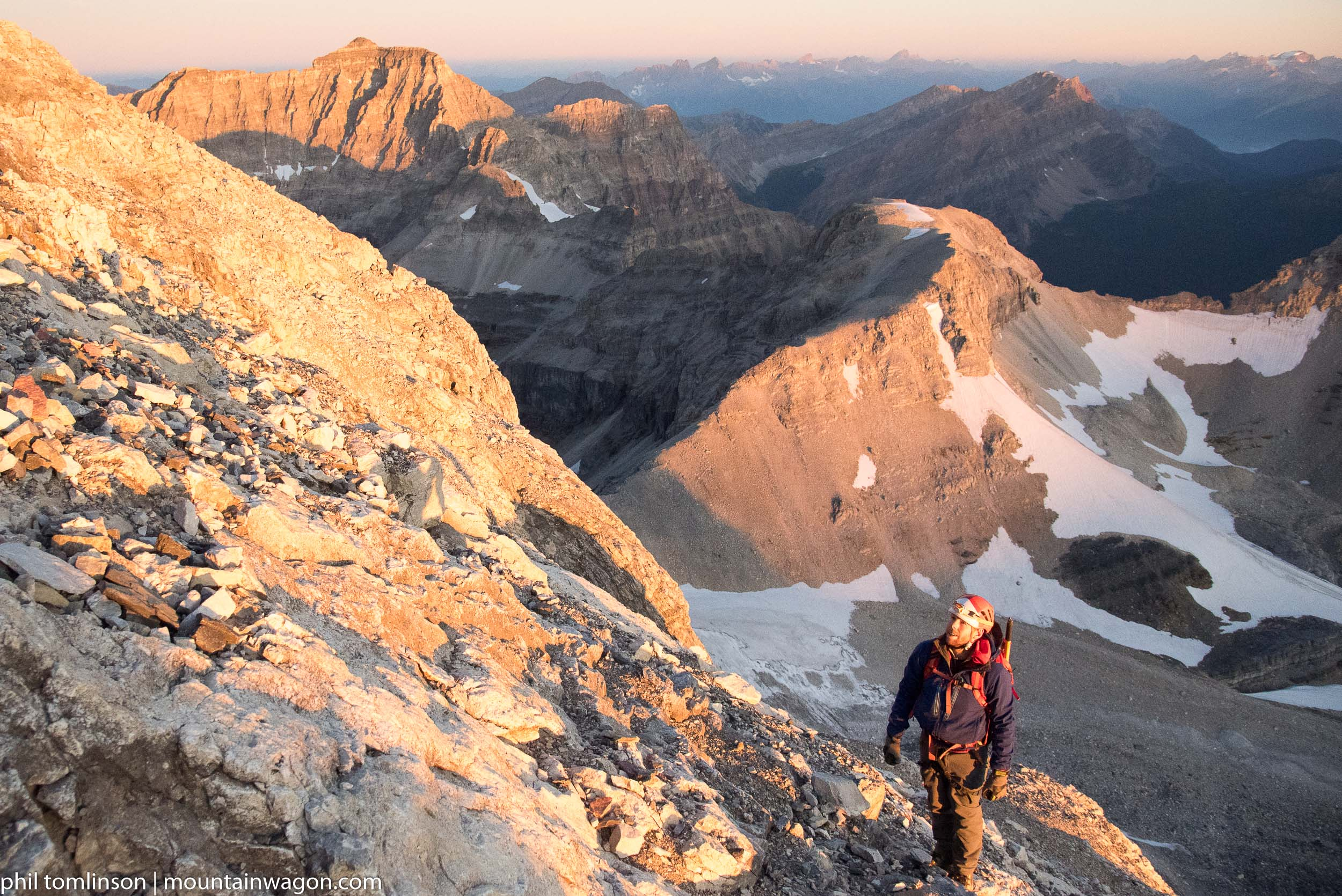 By the time true dawn hit, we were making progress up the slabby lower slopes of Assiniboine
