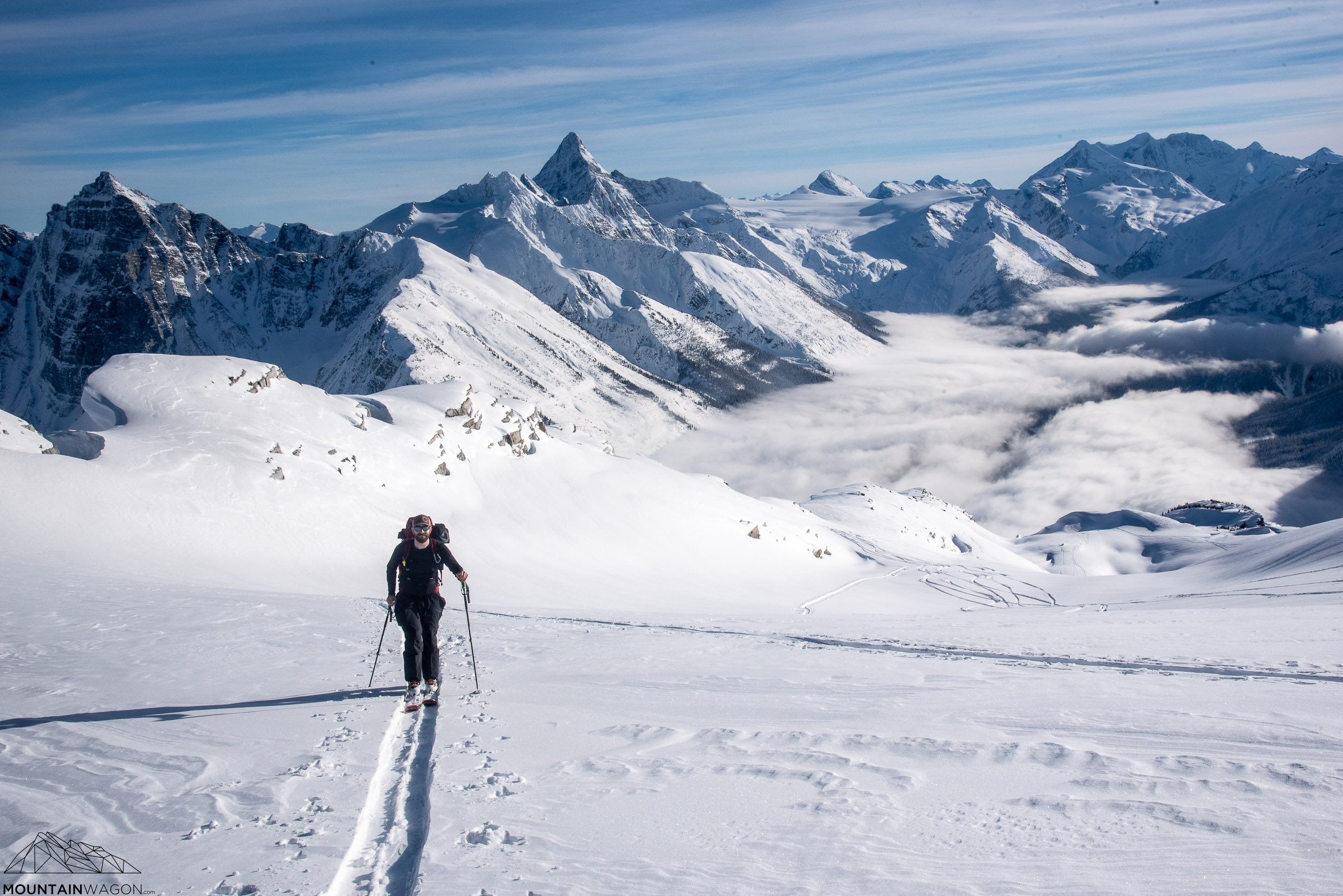Kyle nearing the top of the Little Sifton Traverse with Sir Donald's incredible ridge in the background
