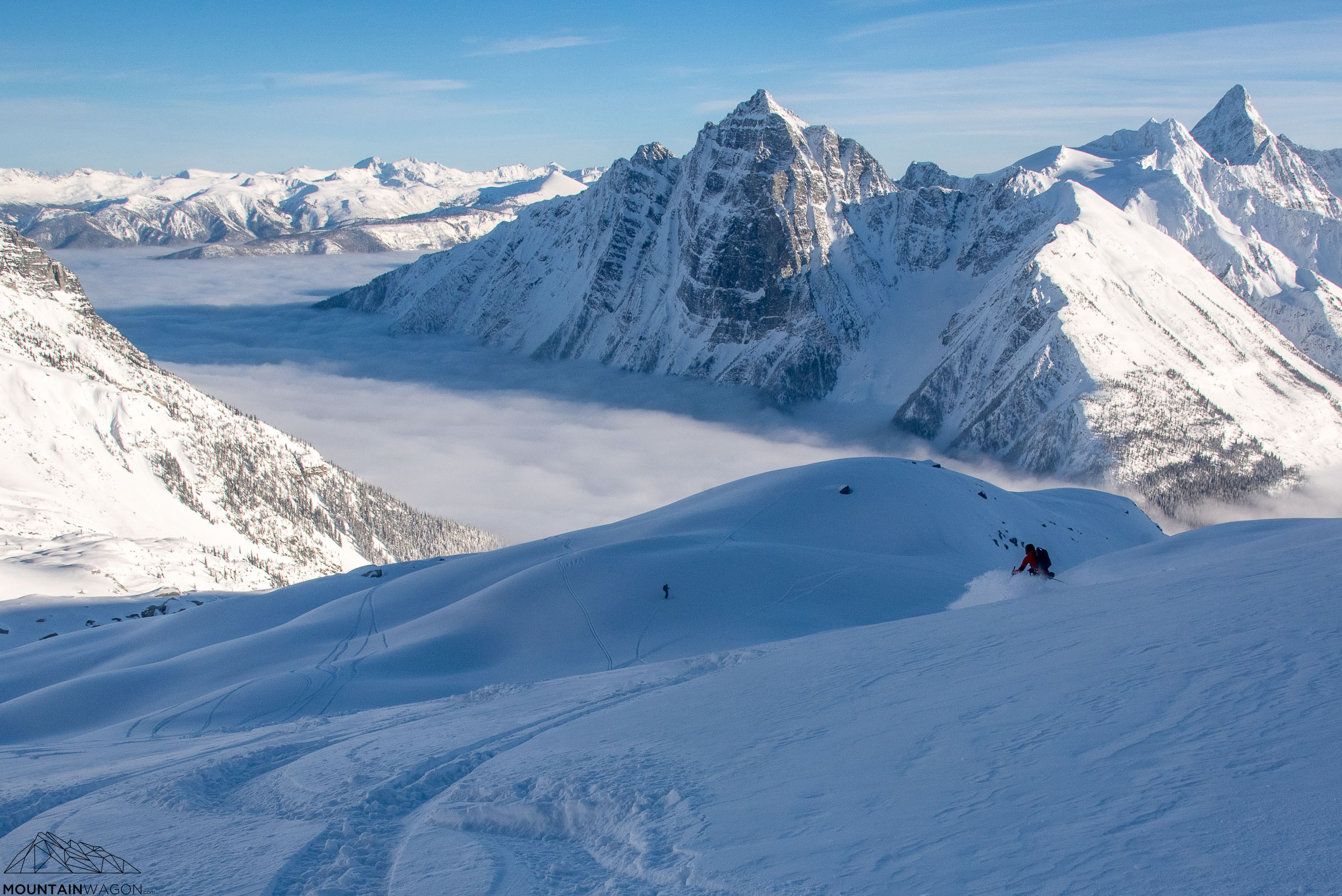 Skyler cruises down the Hermit Glacier with Mount McDonald and Mount Sir Donald in the background.