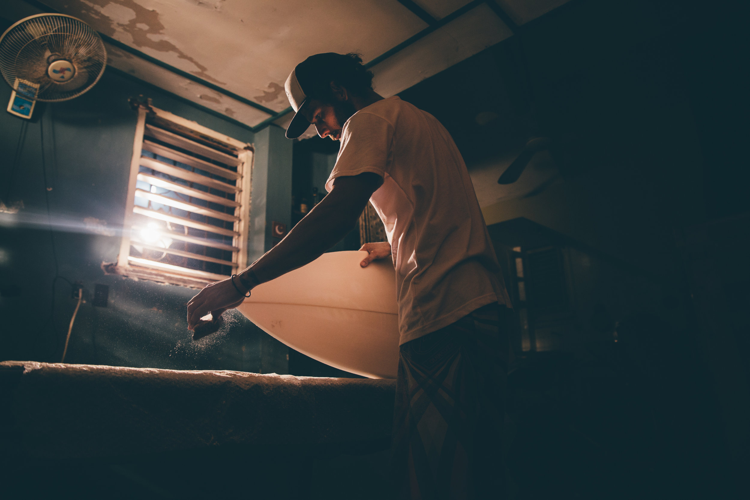 Foam blanks scavenged from refrigerator doors, an old cheese grater used in place of a planer, the ingenuity of the underground Cuban board builder in action. Photo:  Marco