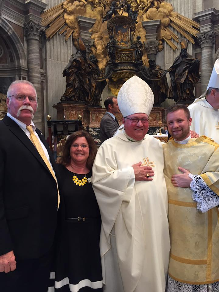 Deacon Andrew Showers with his parents and Bishop Morlino of the Diocese of Madison.