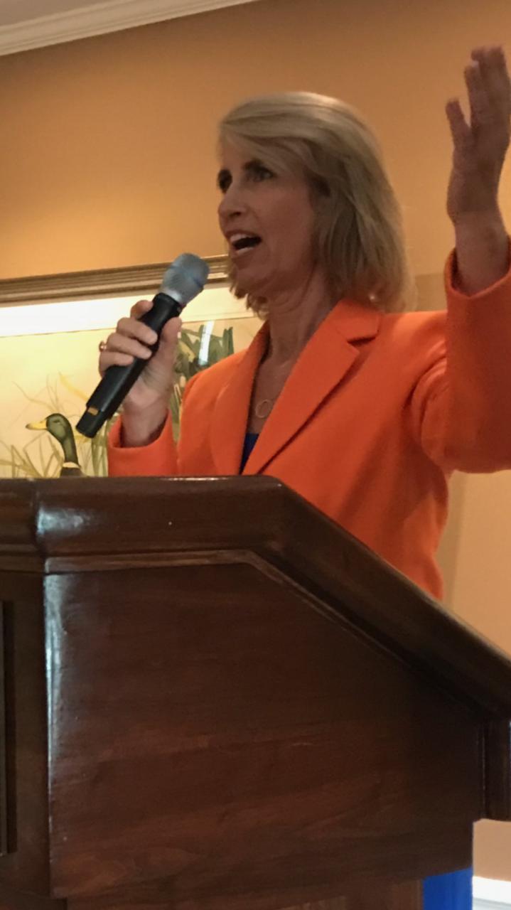 Speaking pic at Harvard podium orange.PNG