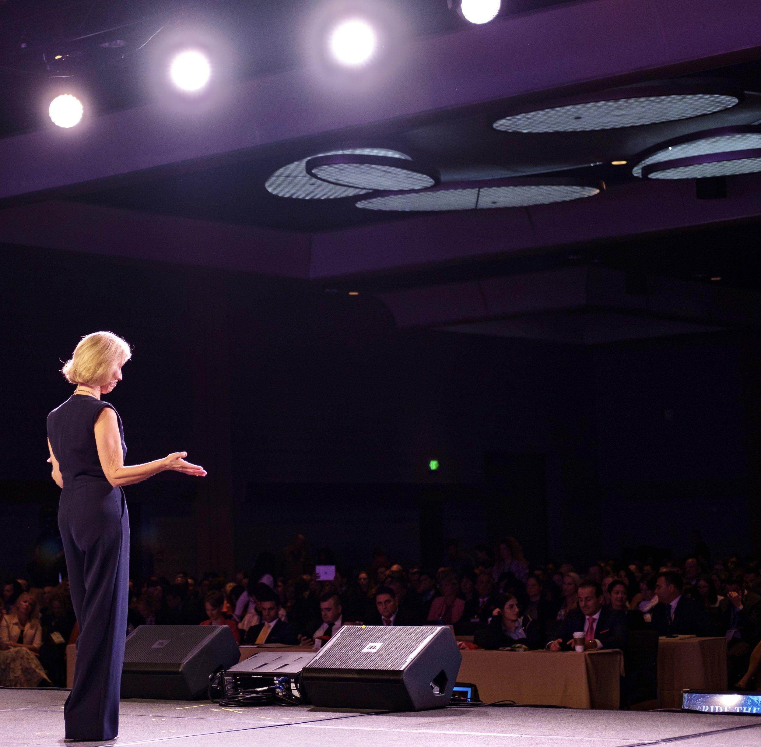 Kirsten Speaking MegaSuccessFromBehind with audience.jpg