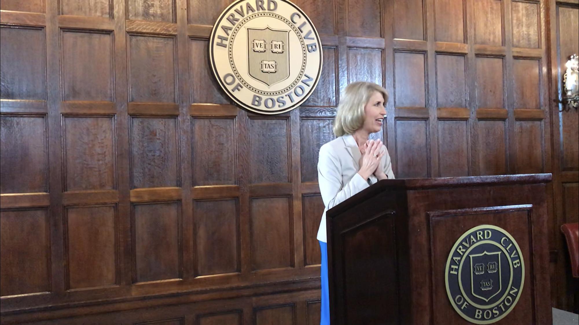 Kirsten Speaking Harvard hands together.PNG