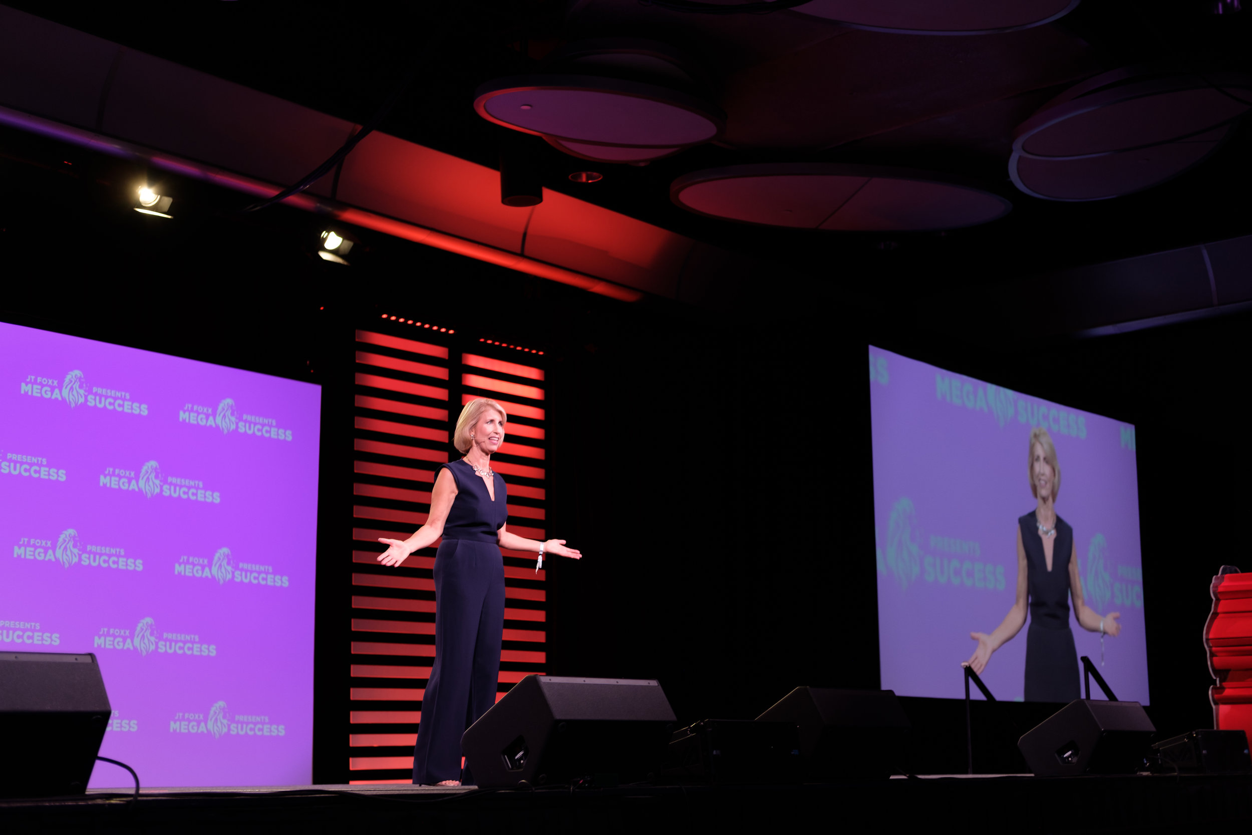 Kirsten Speaking MegaSuccessFar.JPG