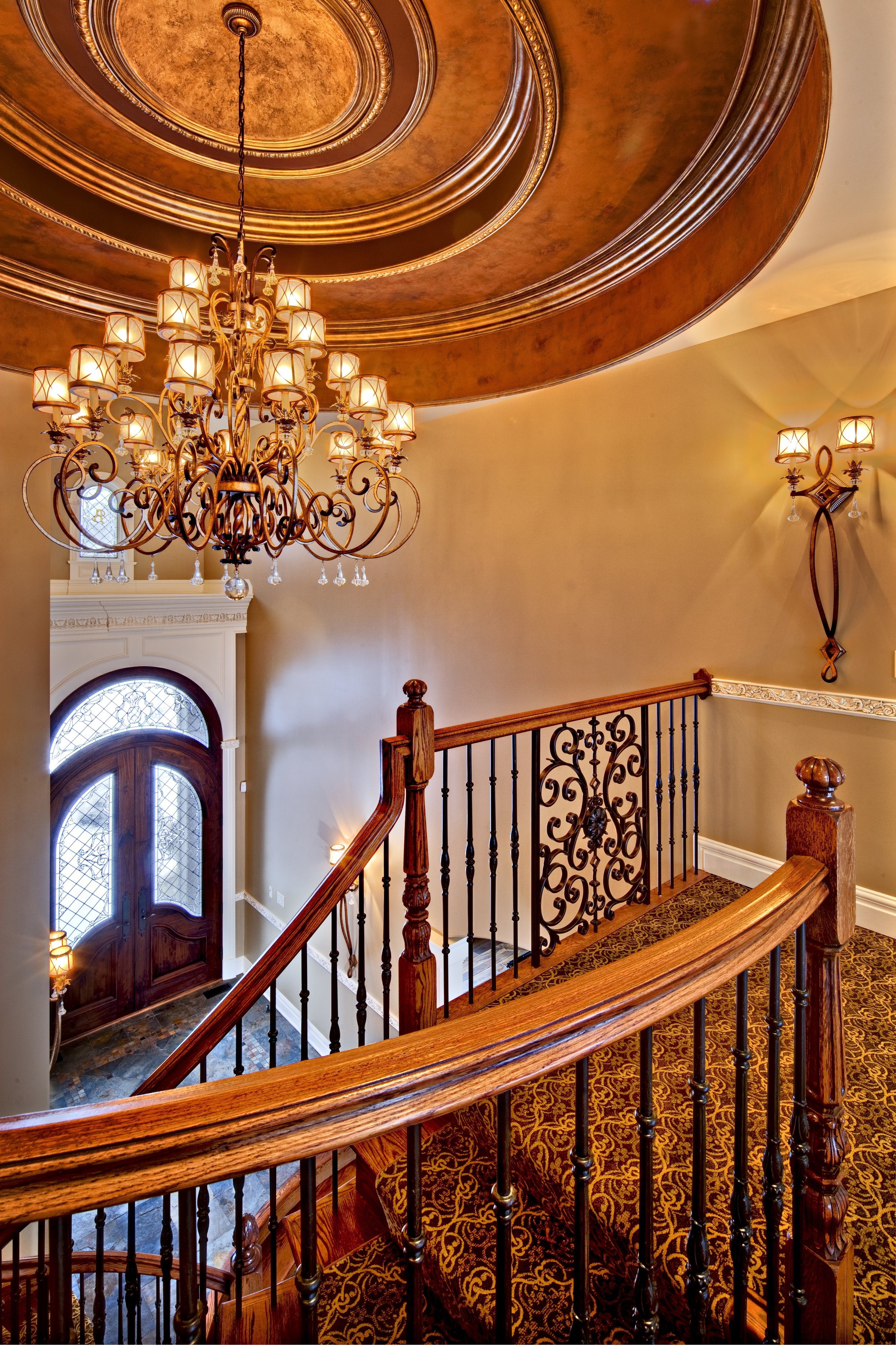 Grand Two Story Foyer with Large Chandelier and Curved Custom Staircase in this Naperville IL. Custom Home