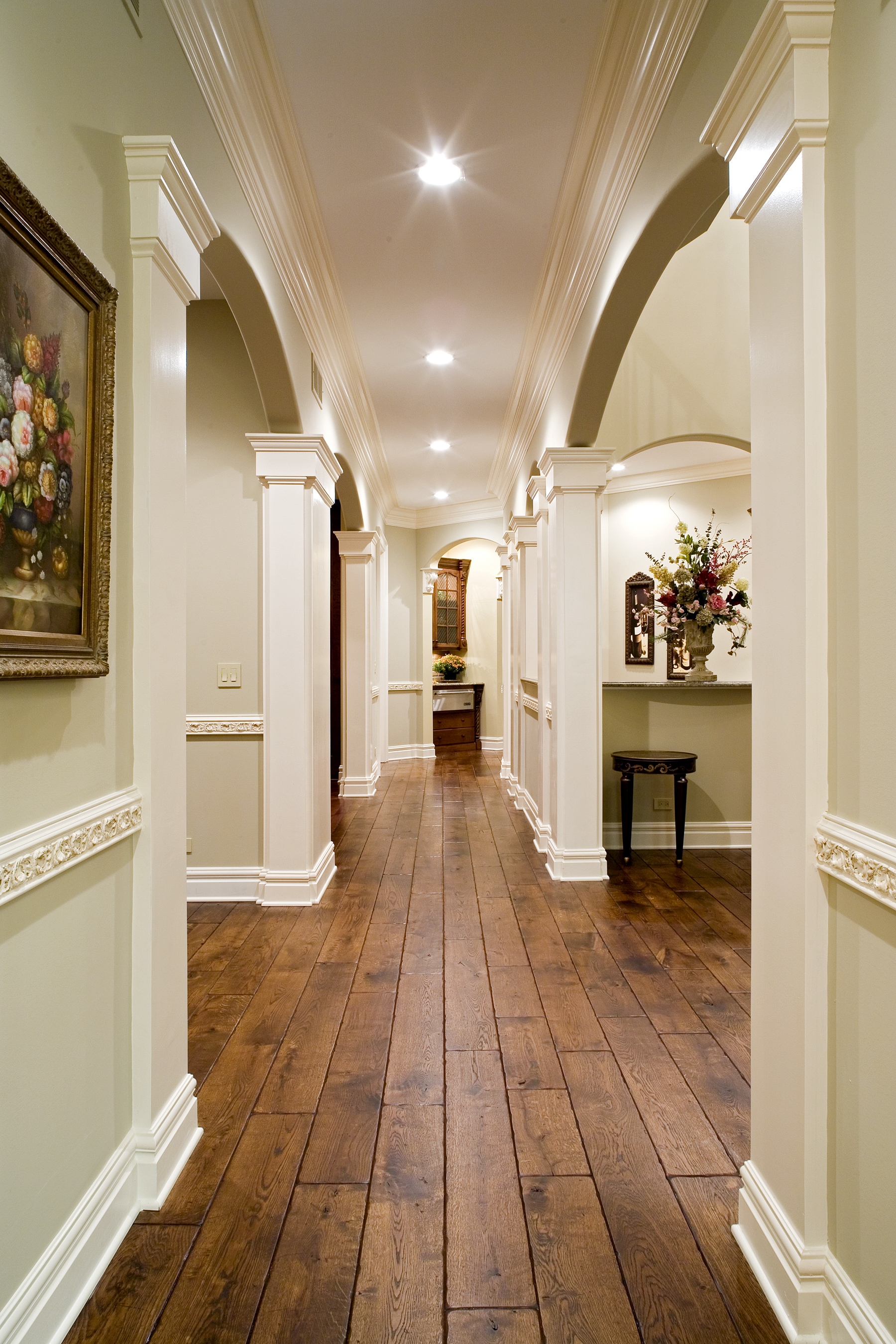 Wide Plank Oak Flooring with Medium Distressed and Hand Scrapped. Carved Chair Rail in this Naperville IL. Luxury Home