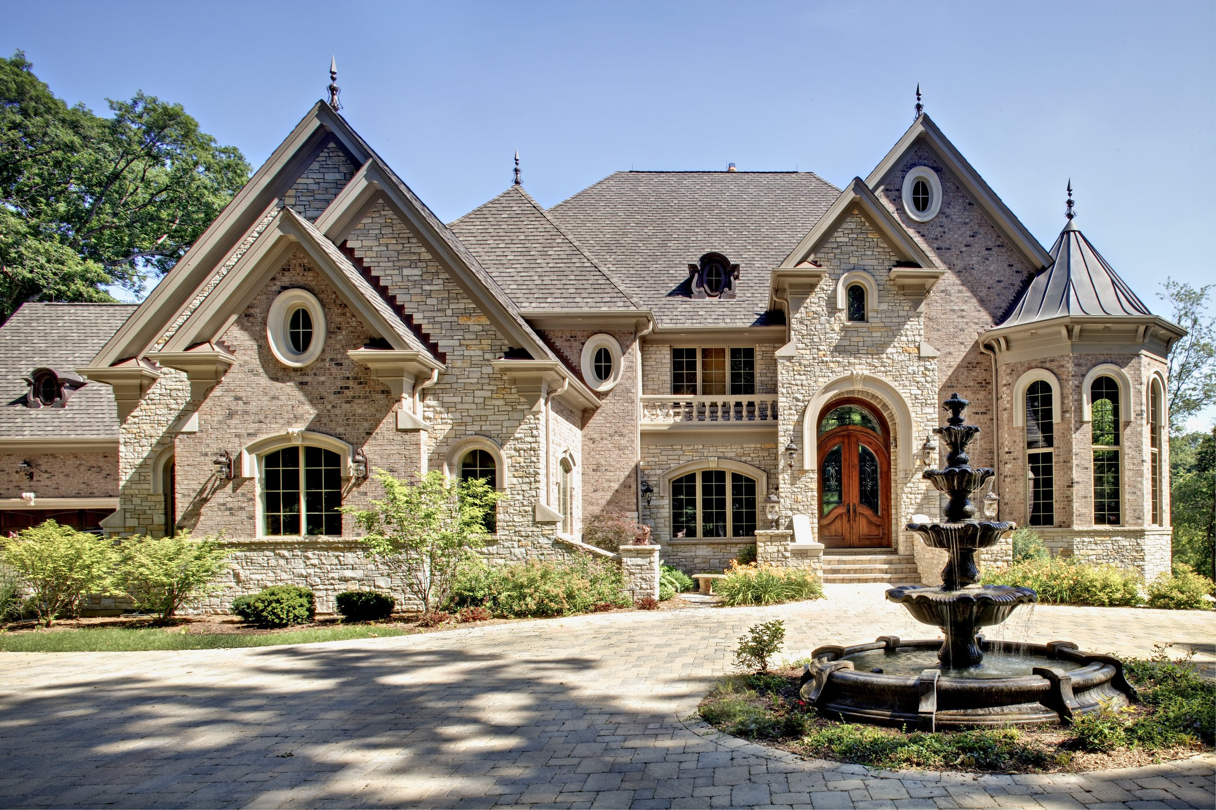 Luxury Custom Home by Southampton in Northern Illinois.  Custom Exterior with Turret and Carved Limestone.