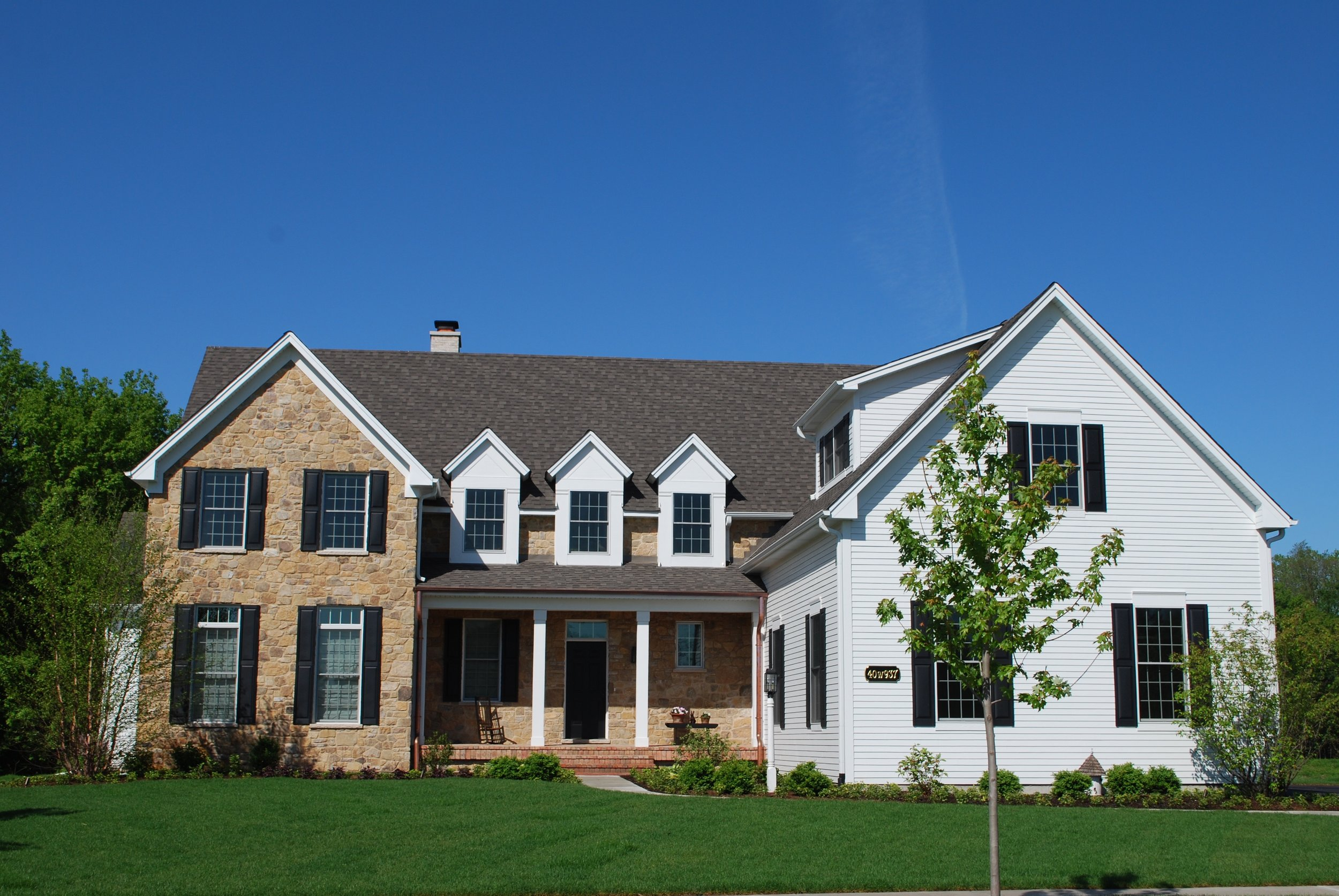 Custom Designed Home in Fox Creek to Replicate East Coast Farm House.  People think it is an Original Farmhouse!