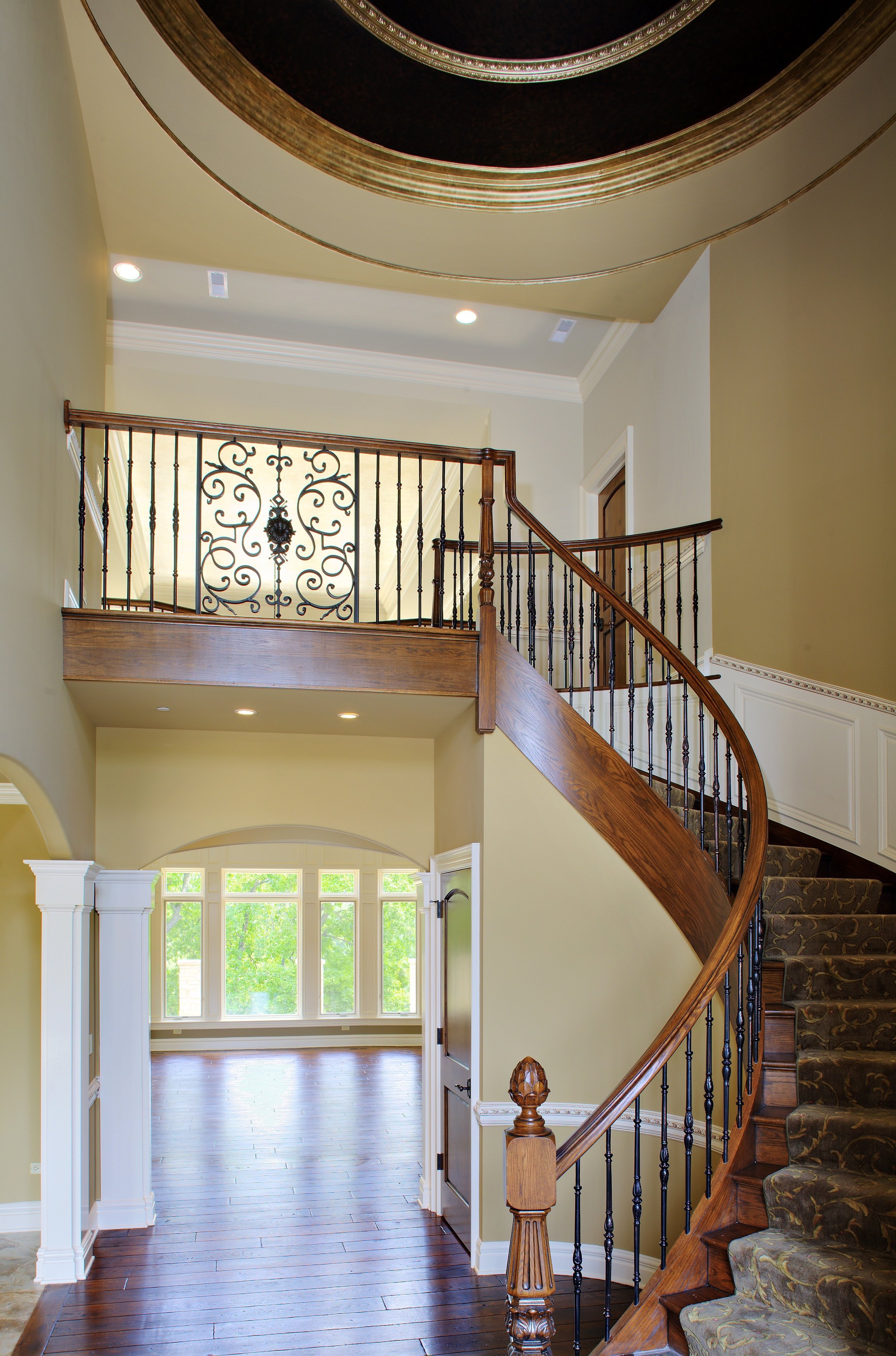 Curved Staircase in Soaring Foyer