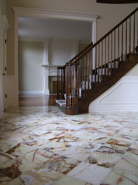 Elegant Foyer with Marble Floor and Curved Staircase