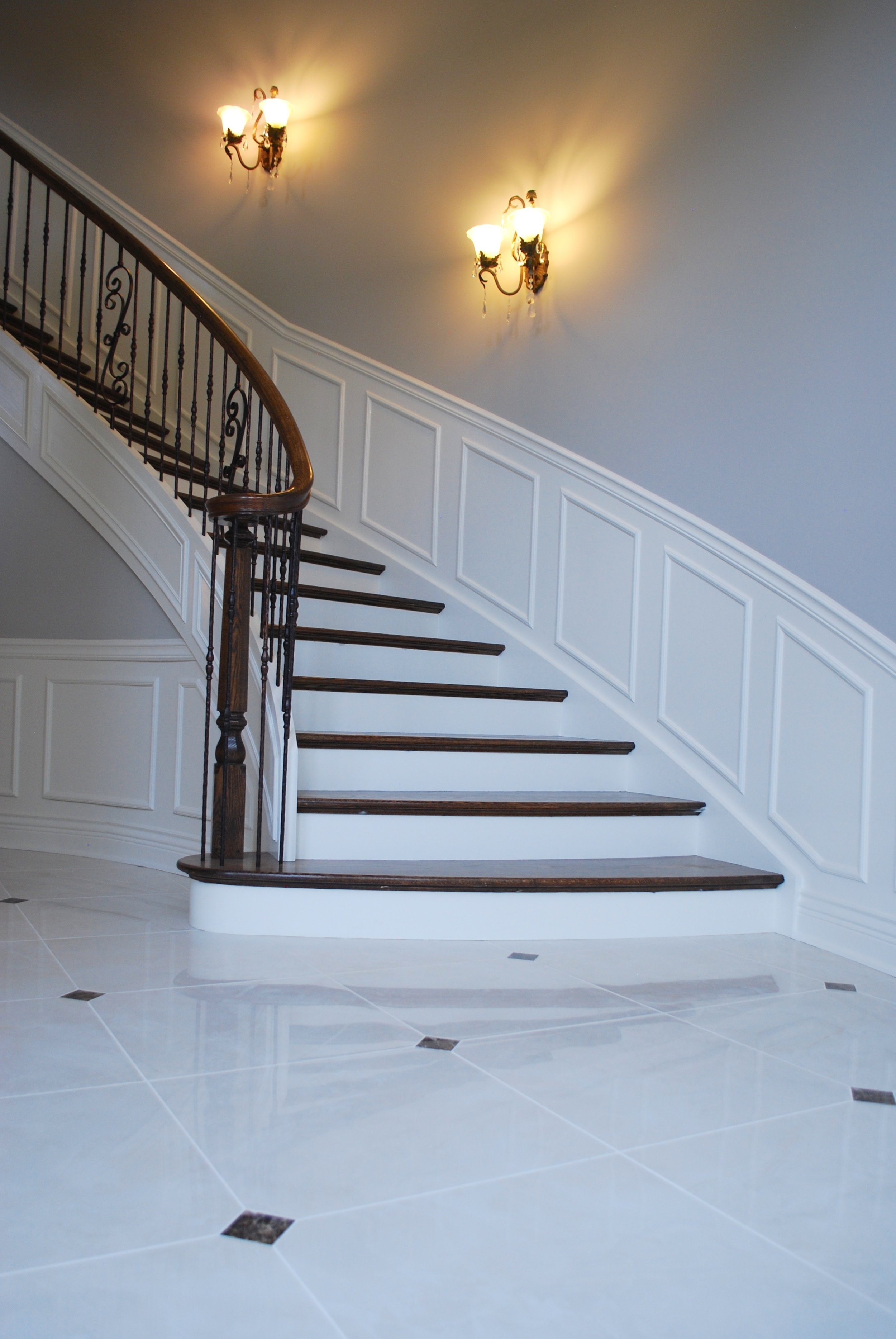 GRAND CURVED WHITE STAIR CASE WITH MARBLE FOYER