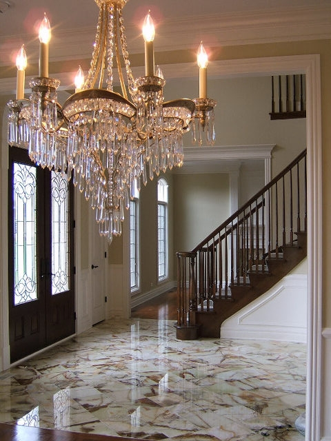 Elegant Foyer with Marble Floors and Curved Staircase