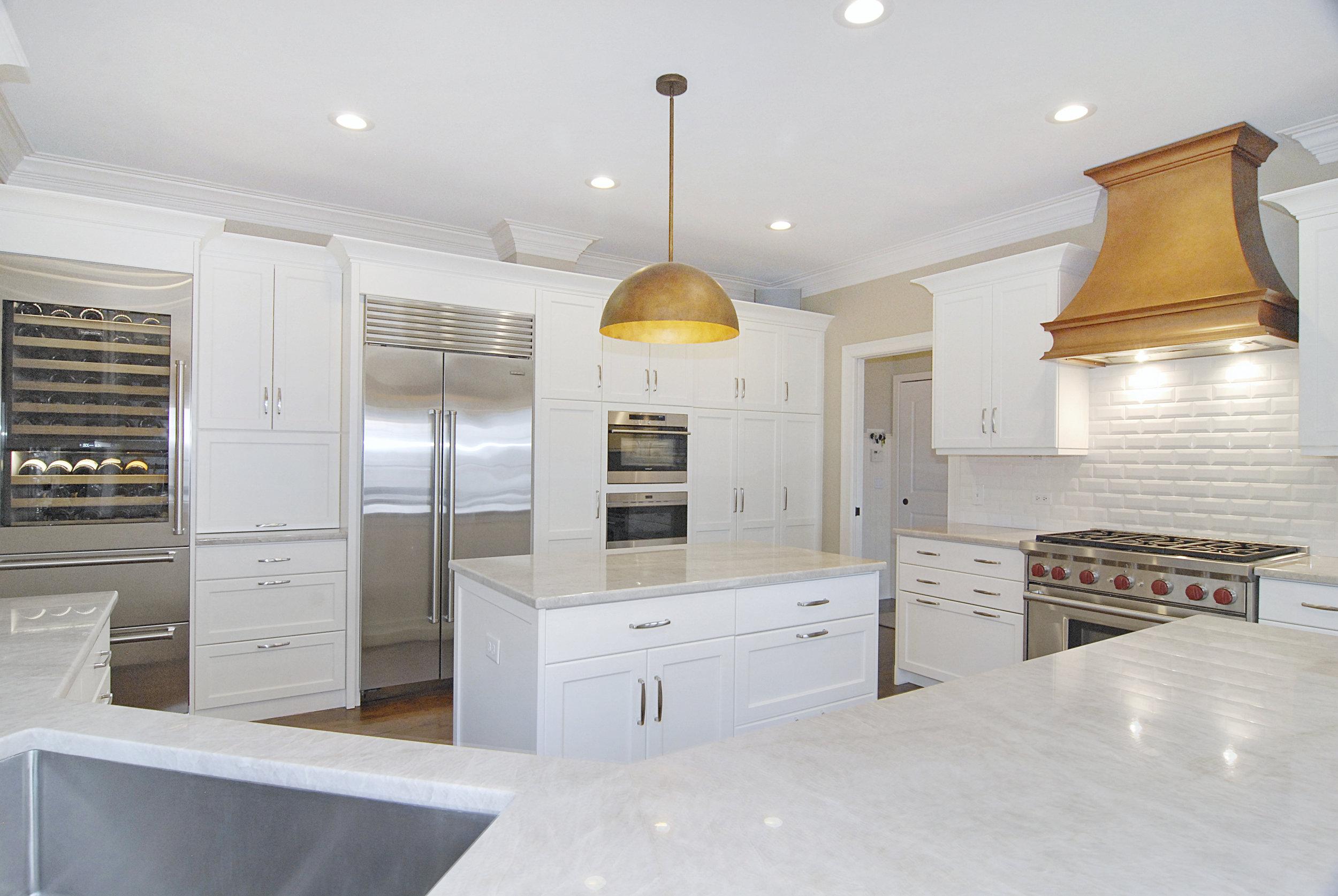Custom Kitchen Remodel with Copper Hood & Iceberg Quartzite