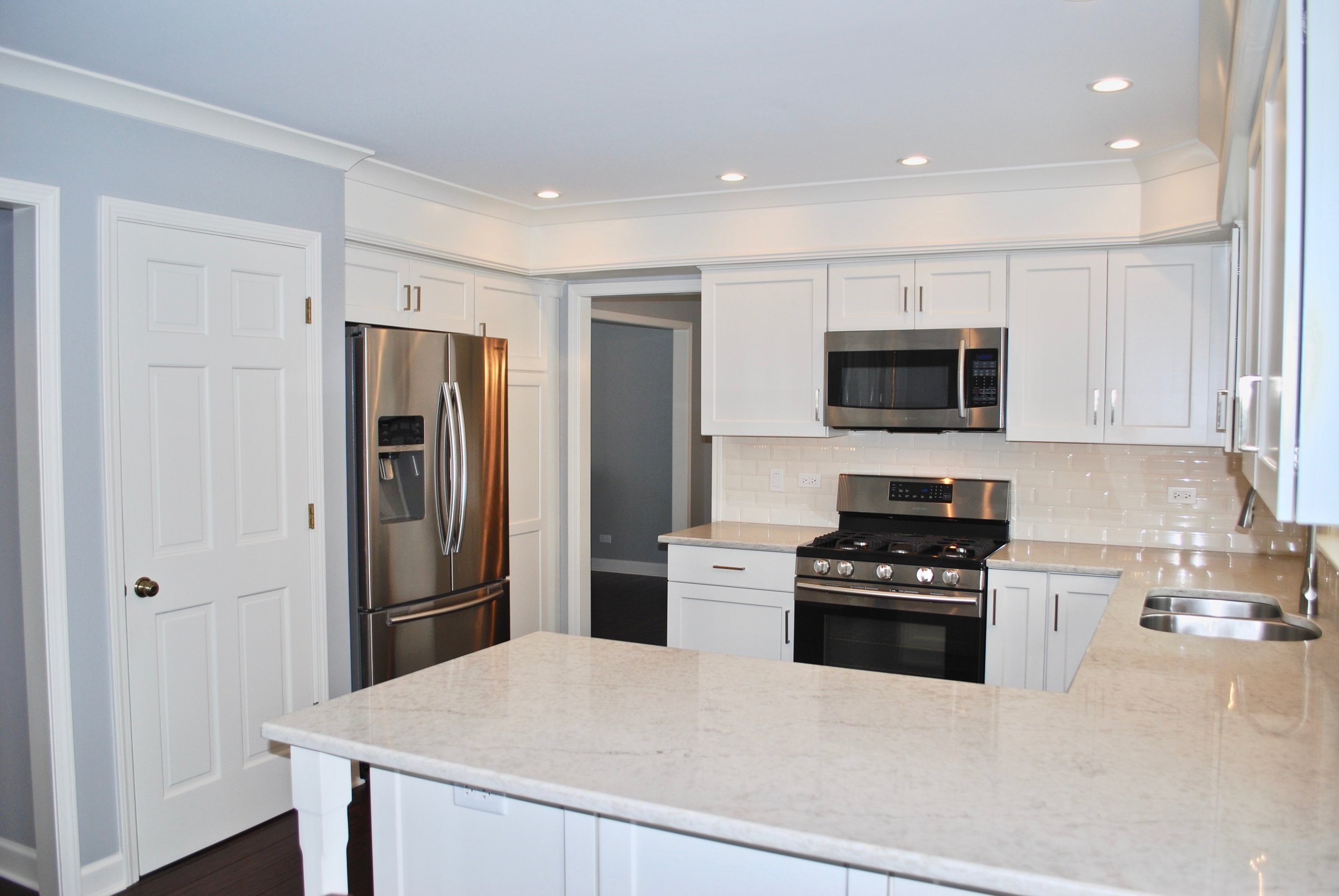 Quartz Counters with Off White Cabinetry.