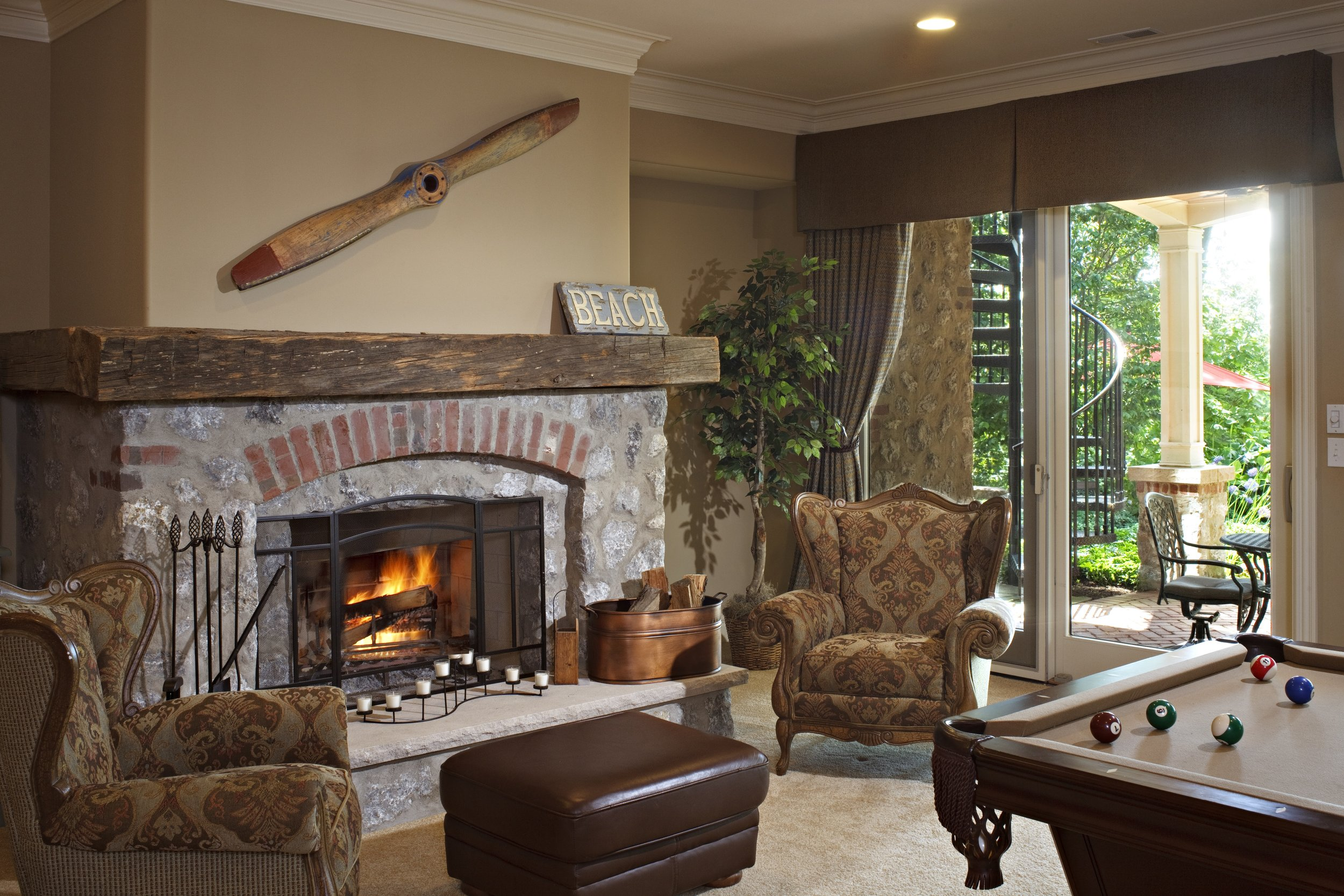 BASEMENT STONE FIREPLACE IN WALKOUT BASEMENT.  FINISHED BASEMENT IN ST. CHARLES IL.