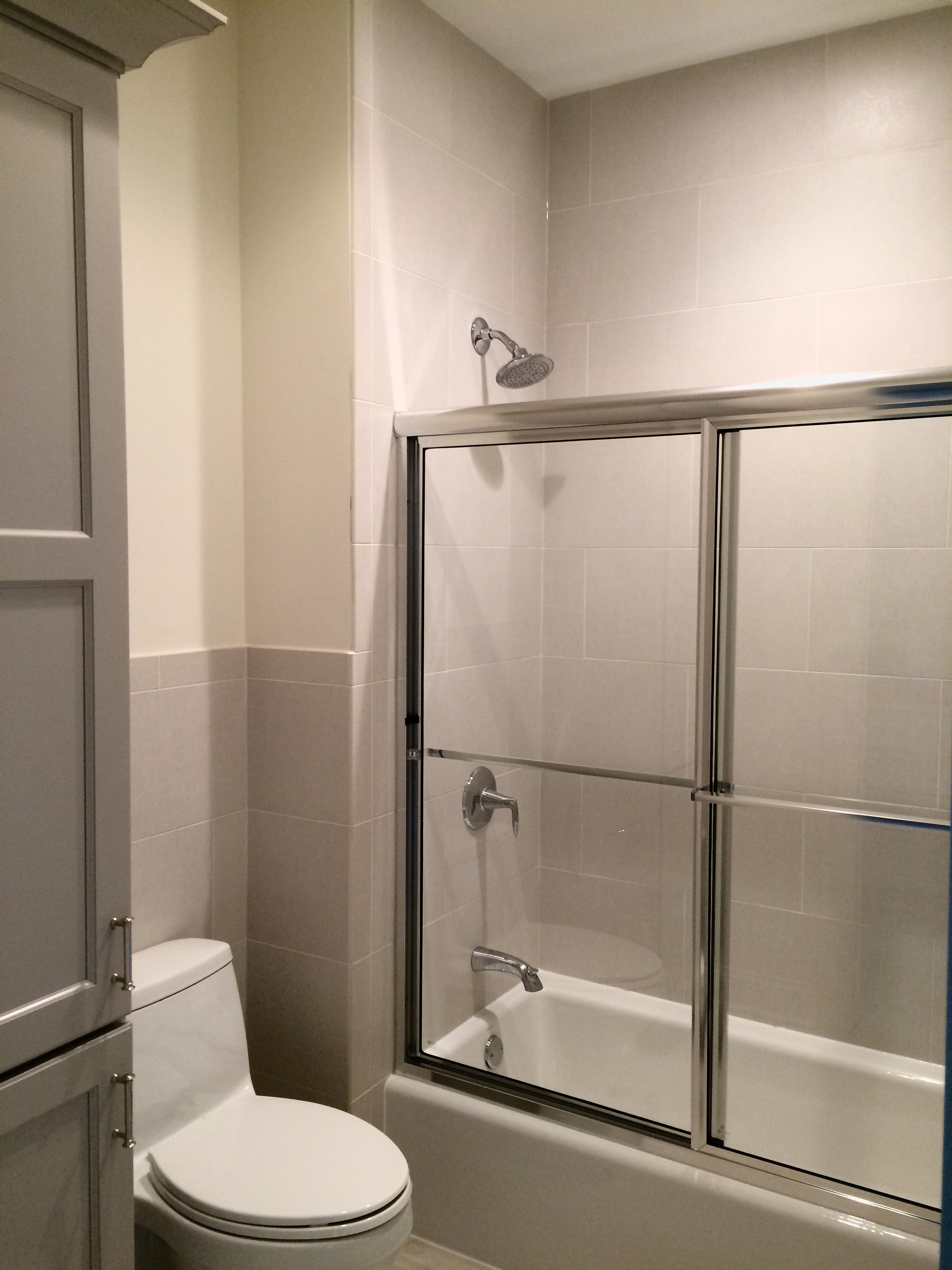SHARED BATHROOM REMODEL WITH TALL LINEN CLOSET IN GENEVA IL