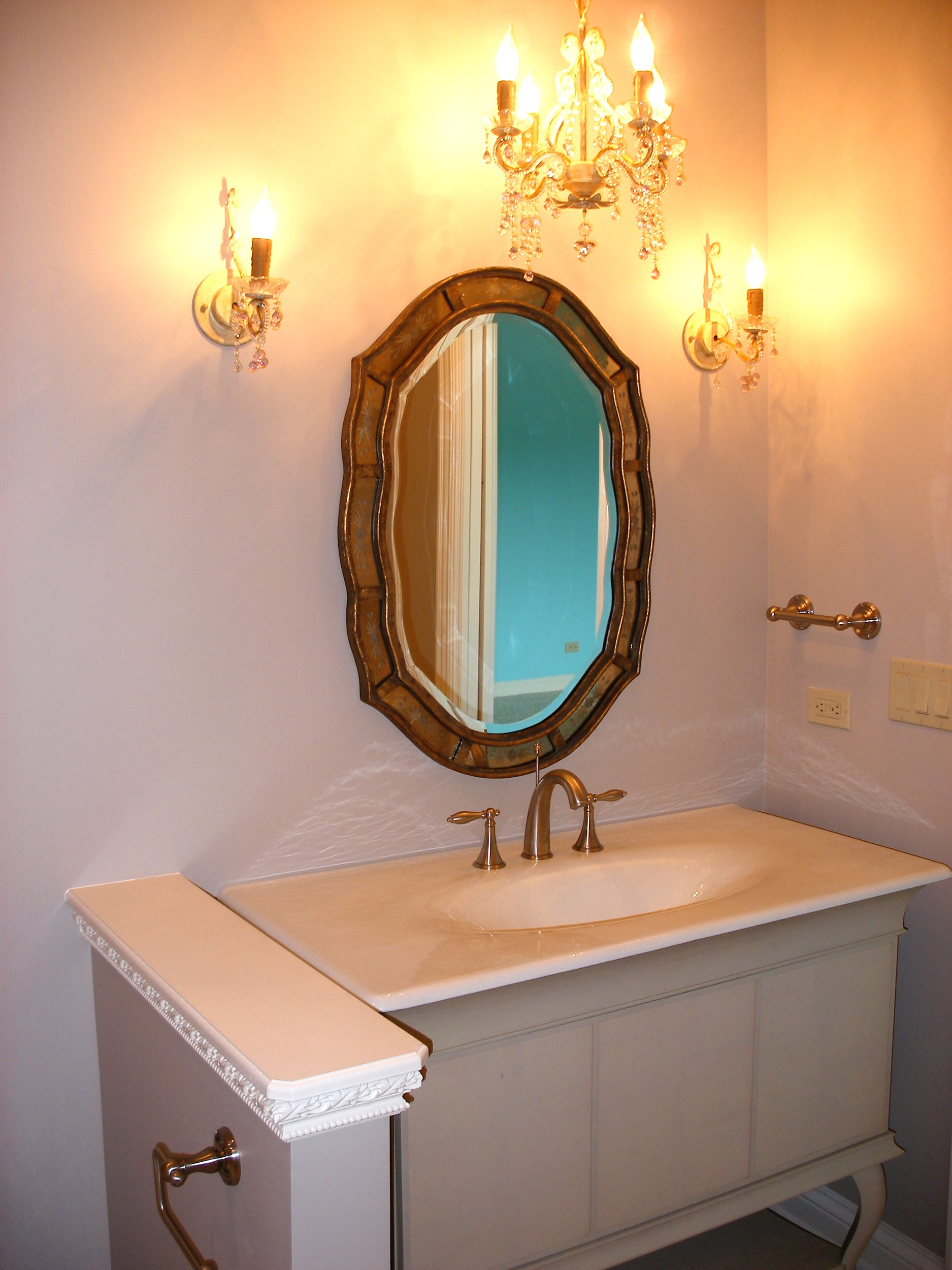 SCONCES ON SIDES OF MIRROR IN ST. CHARLES IL BATH REMODEL