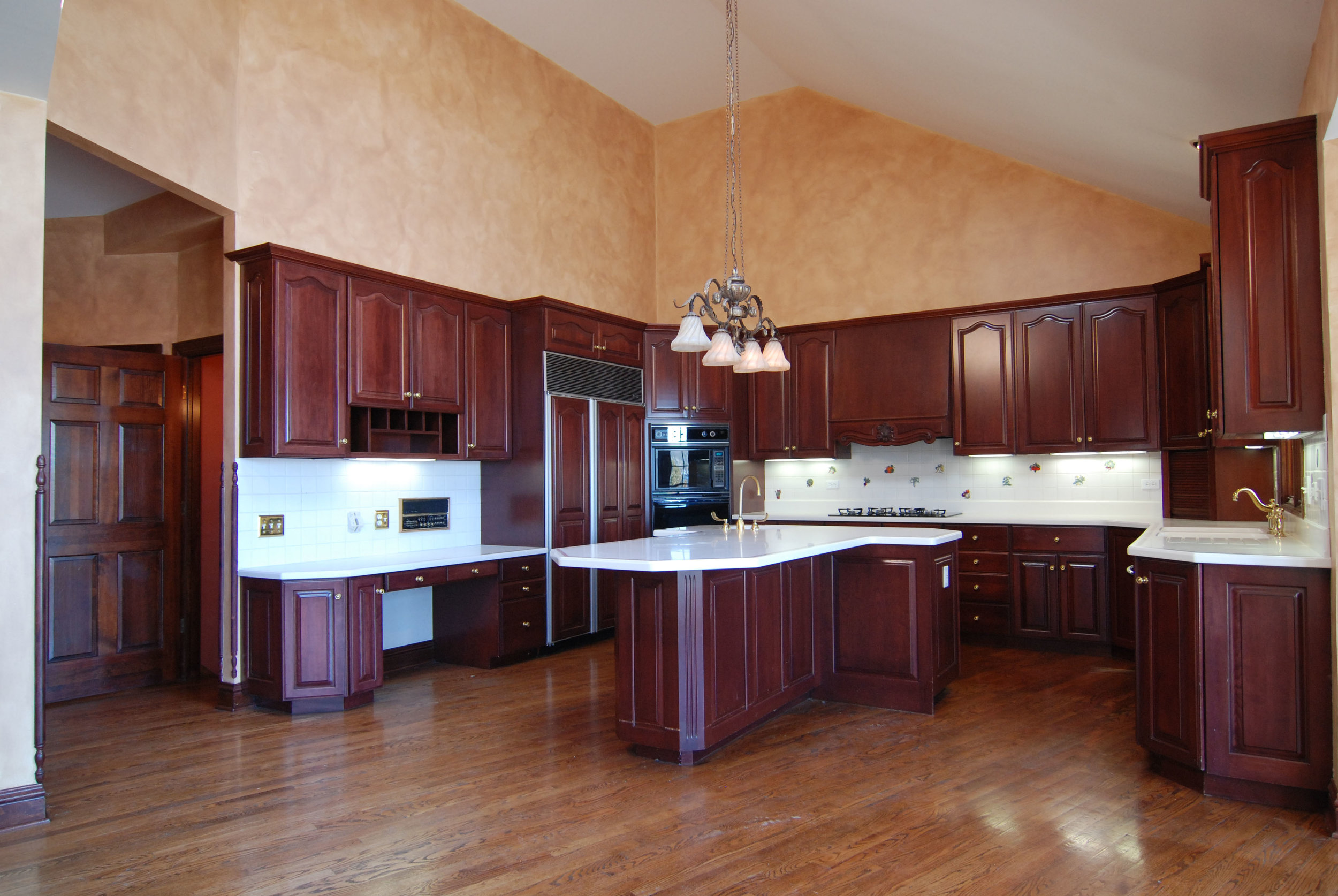 Naperville Illinois Outdated Kitchen with Cherry Cabinetry & White Corian Counters. Helps I am Stuck in the 90's!
