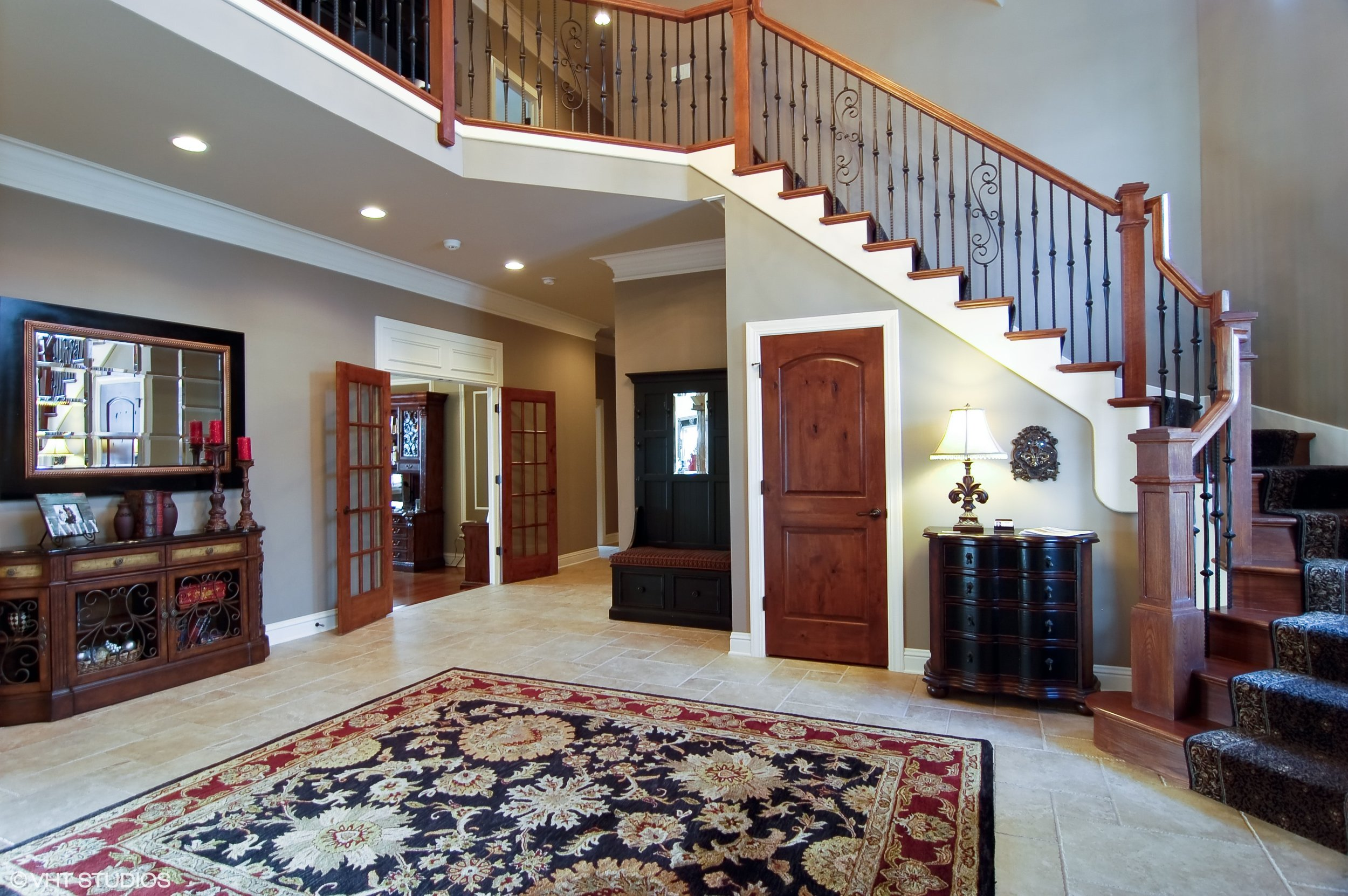 Northern Illinois Foyer Remodeling Specialist With New Stairs, Remodeling Current Stairs and Custom New Handrails & Newels. Square Balusters. White Treads.