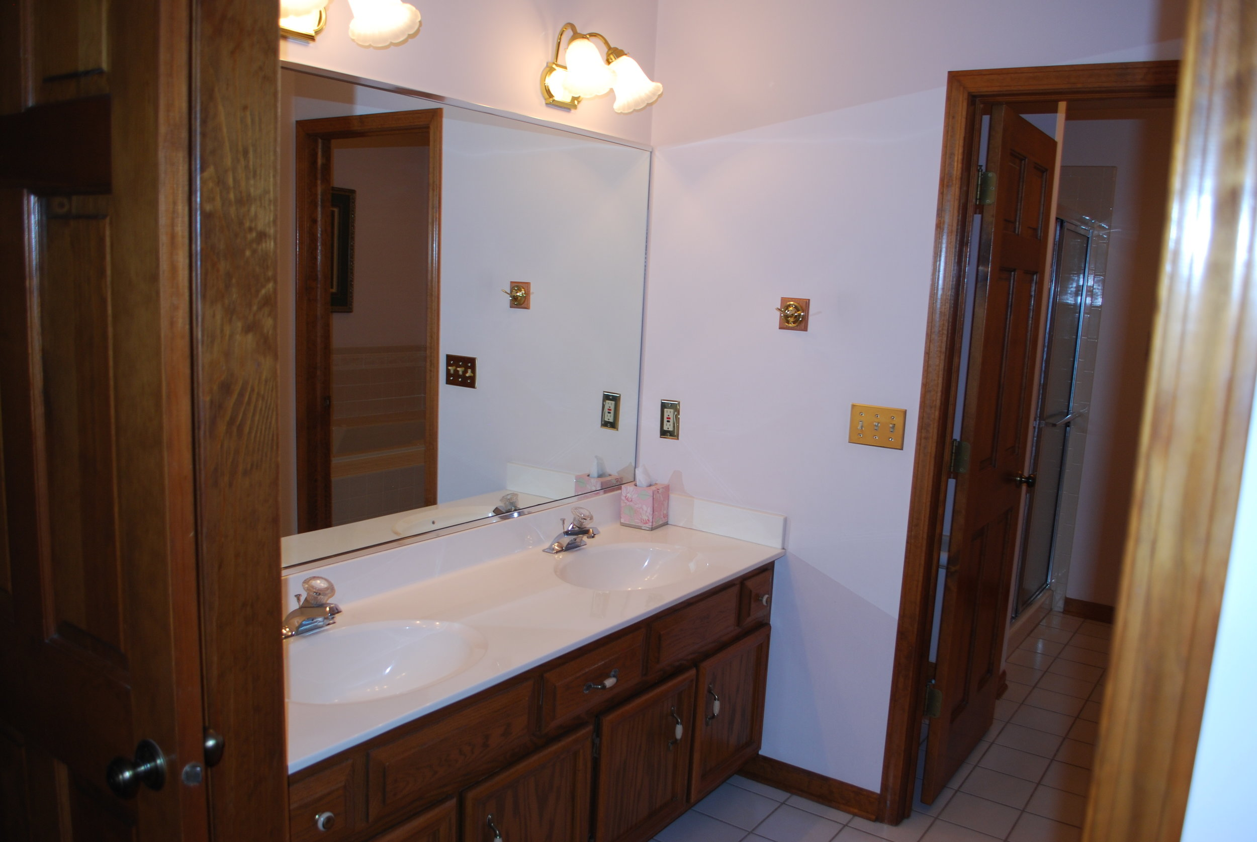 BEFORE photo of a Naperville Bathroom Vanity Remodel with New Vanity, Granite Counters, Custom Medicine Storage Cabinet and Two Mirrored Medicine Cabinets for Extra Storage in this End Unit Townhome.