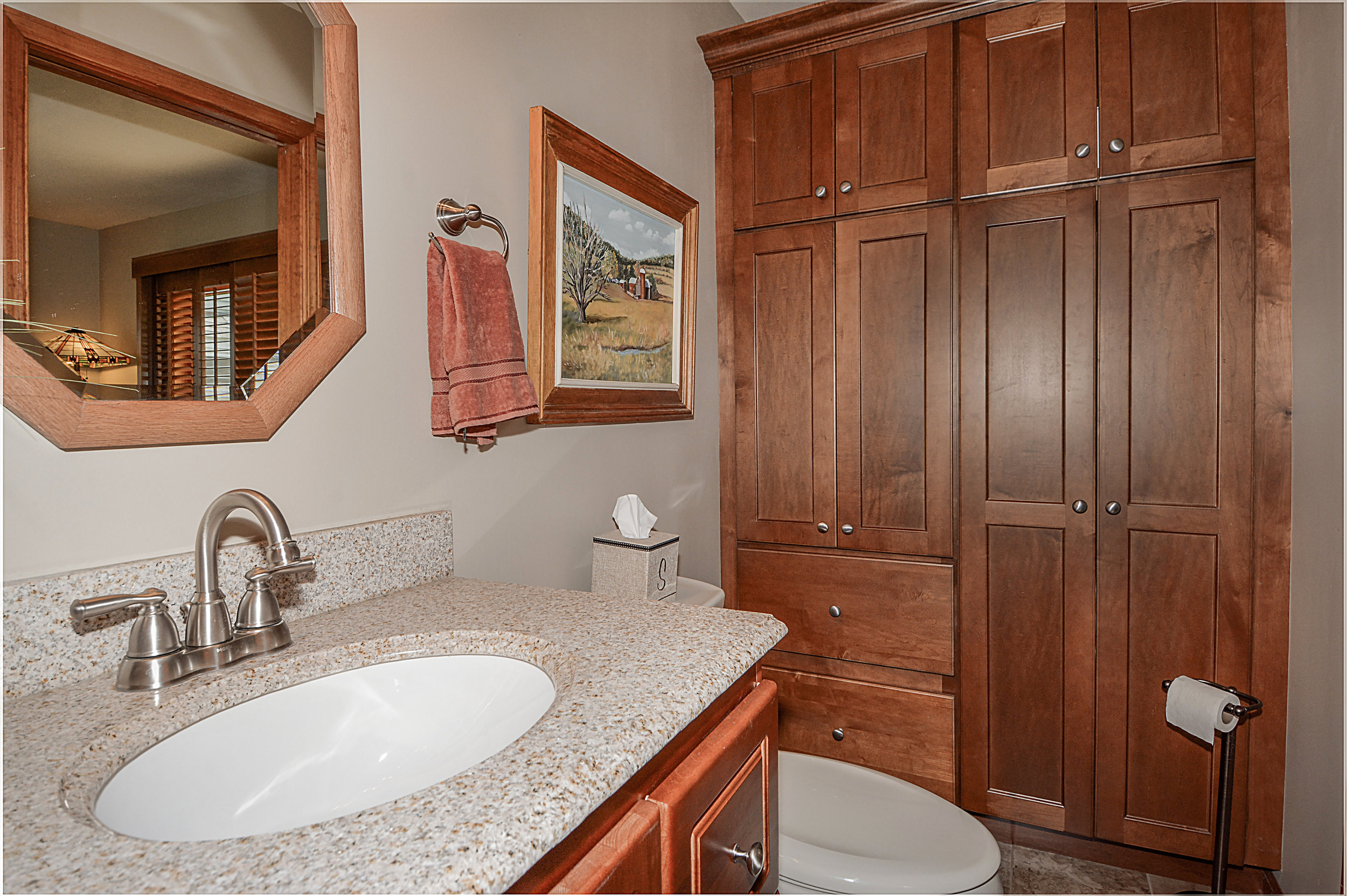 New Vanity in This Guest Bathroom & We Added Storage Cabinetry for Extra Linens and a Vacuum Cleaner. Updating a Bathroom Before Listing for Sale can Create a Faster Sale with Higher Returns. Naperville Il. Remodeled Townhome. Townhome Renovations & Updating.