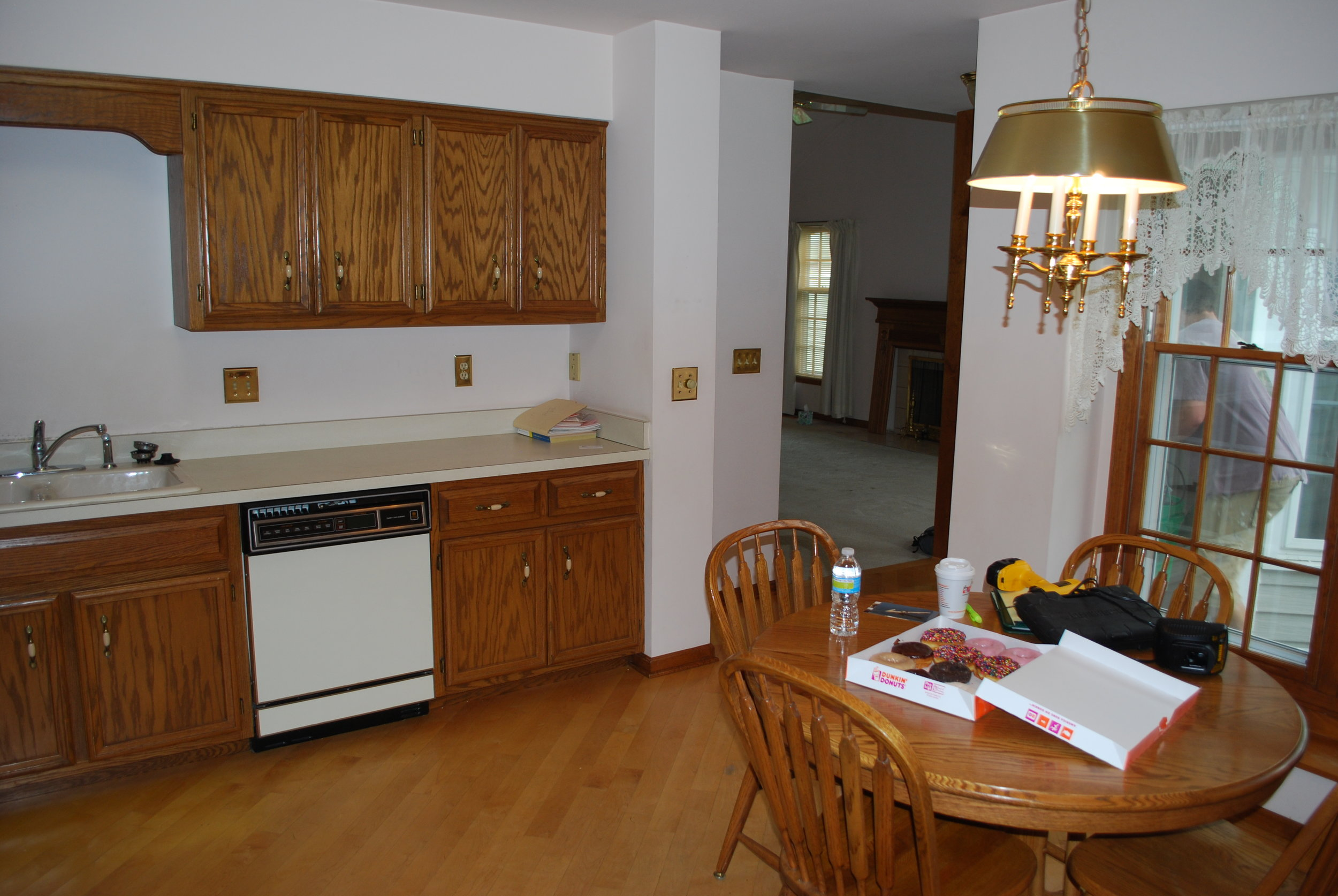 Kitchen in Naperville Townhome End Unit Before Updating. First Floor Updating & Refinished Flooring.