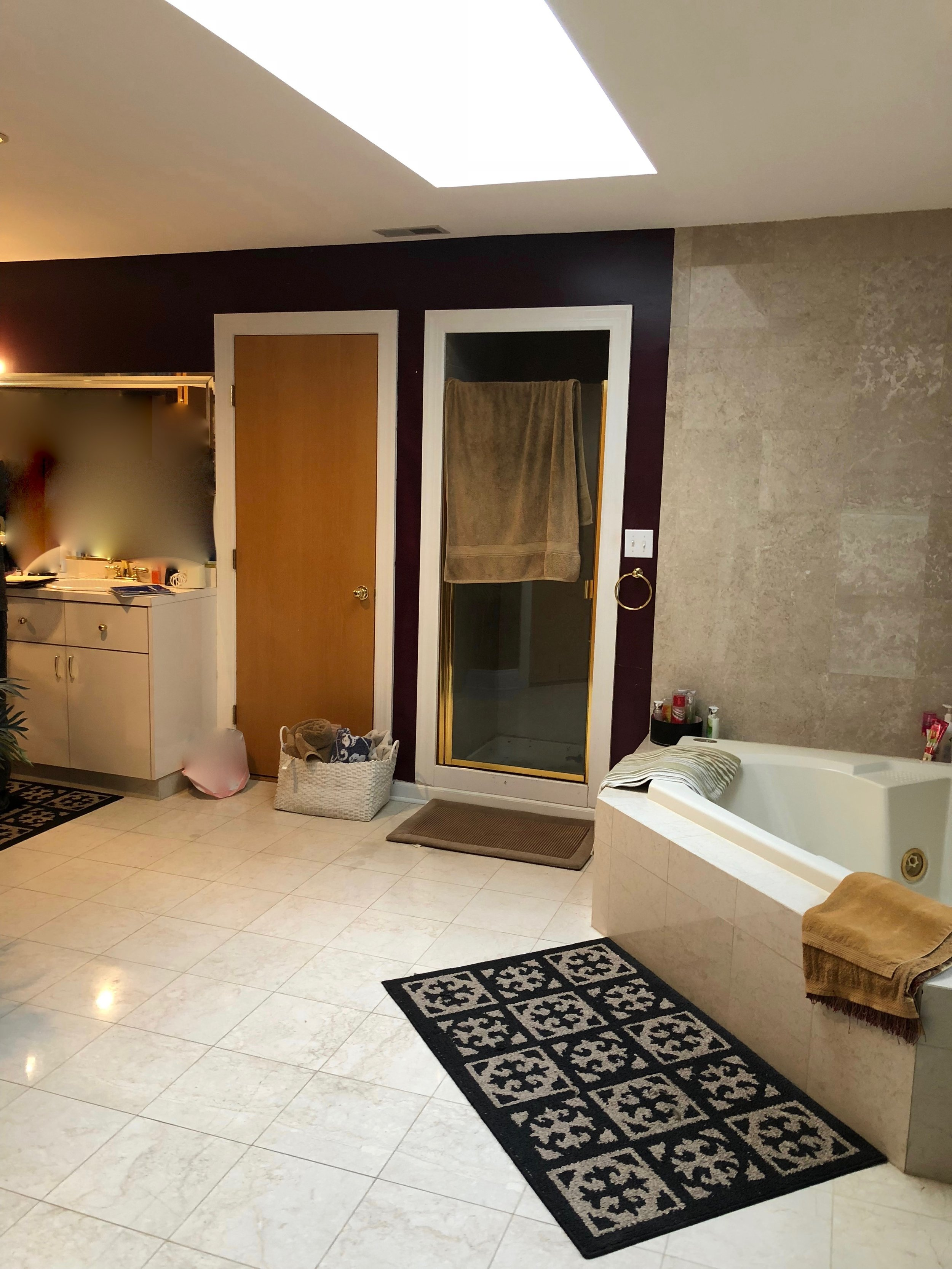 Bathroom Remodel Before Photo with Corner Tub and Small Fiberglass Enclosure Shower in this Oversized Room- Geneva IL