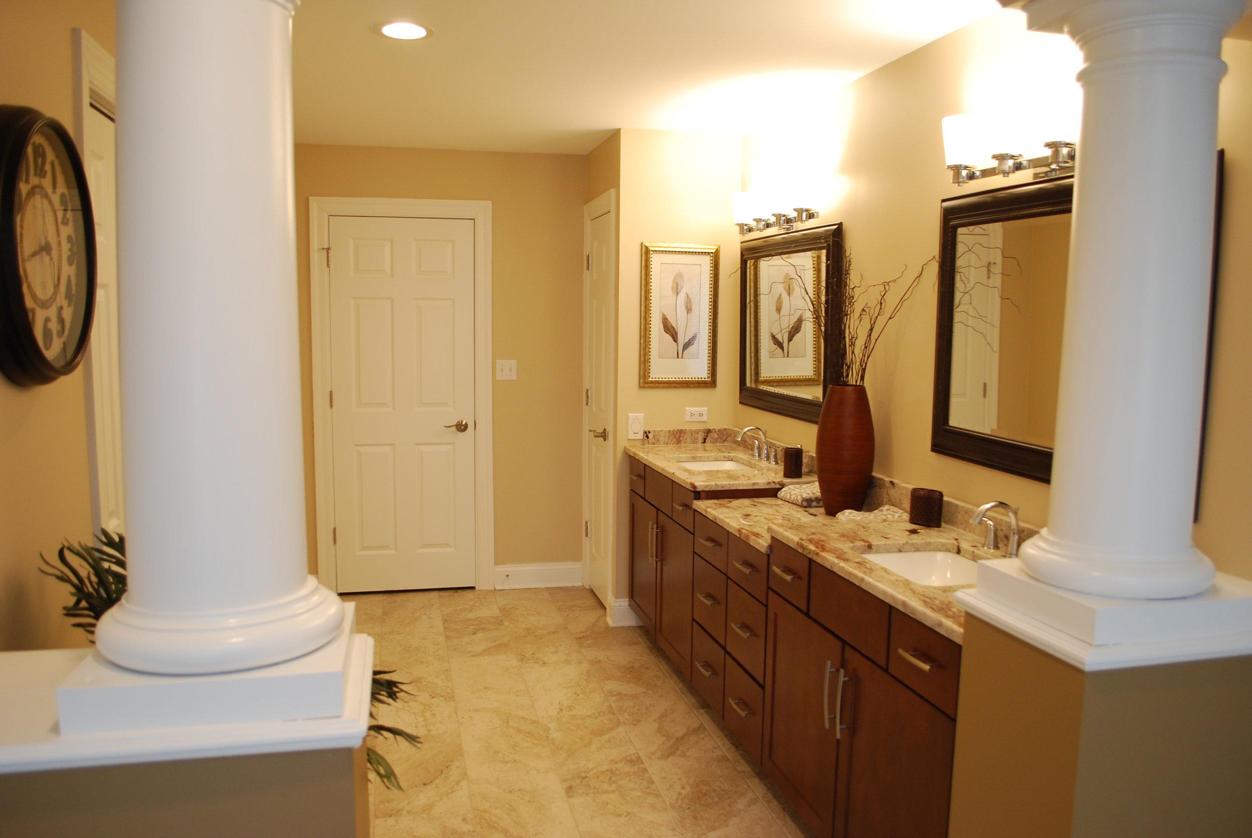 Pillars in Bathroom to Separate Vanity Sinks and Shower