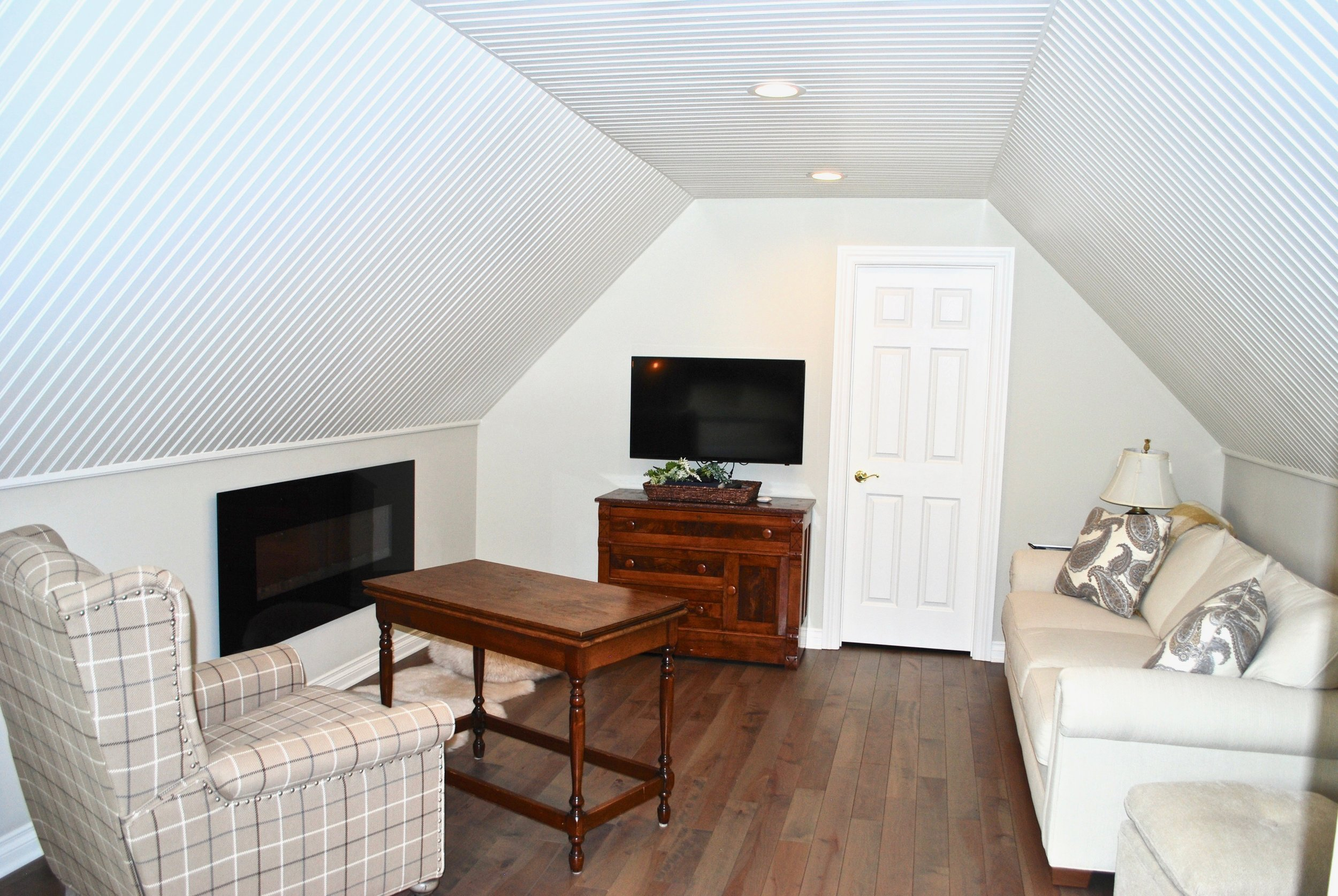 Family Room in Attic Remodel for Out of Town Guests .jpg