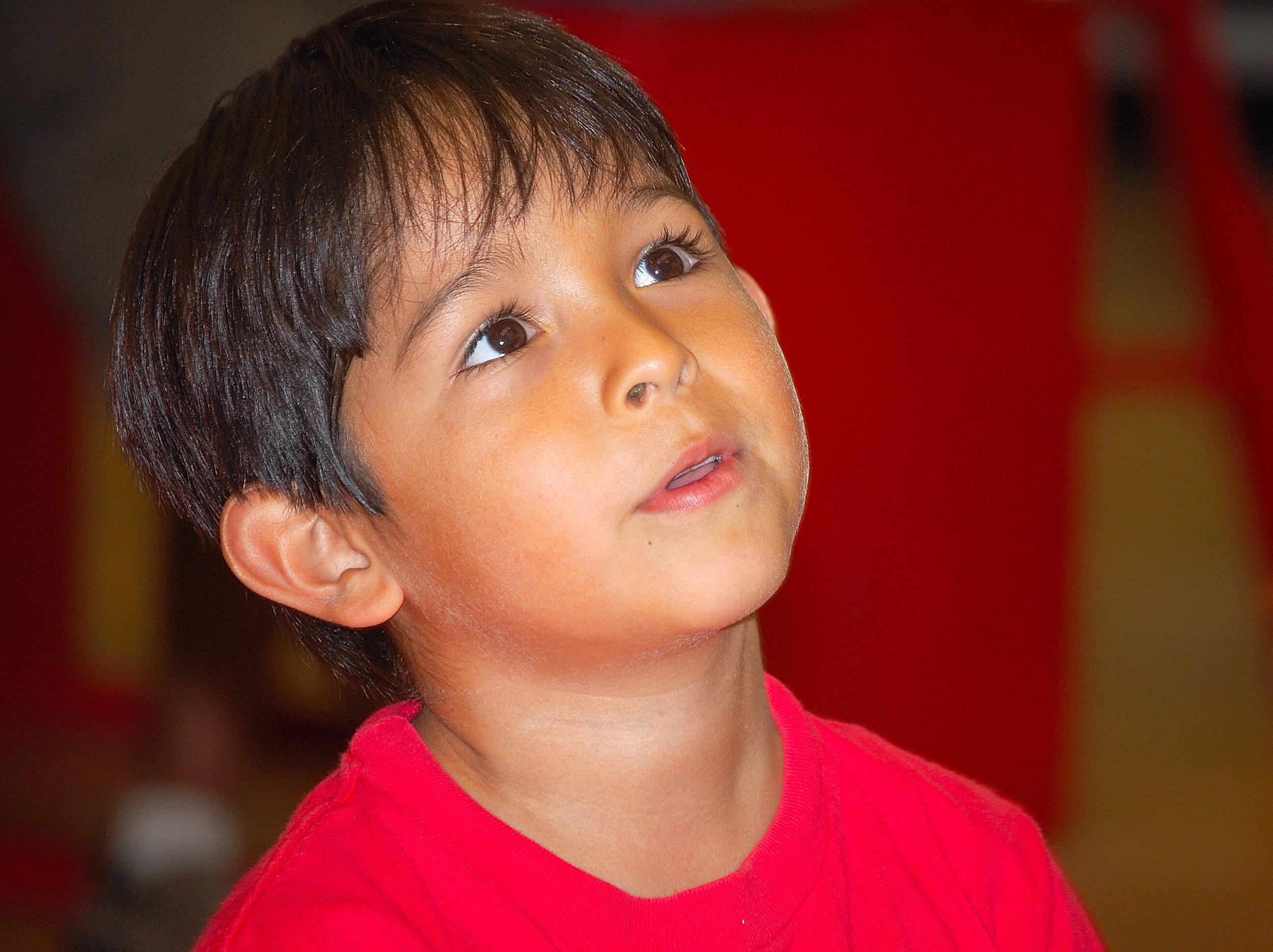 Listening boy in red (2).jpg