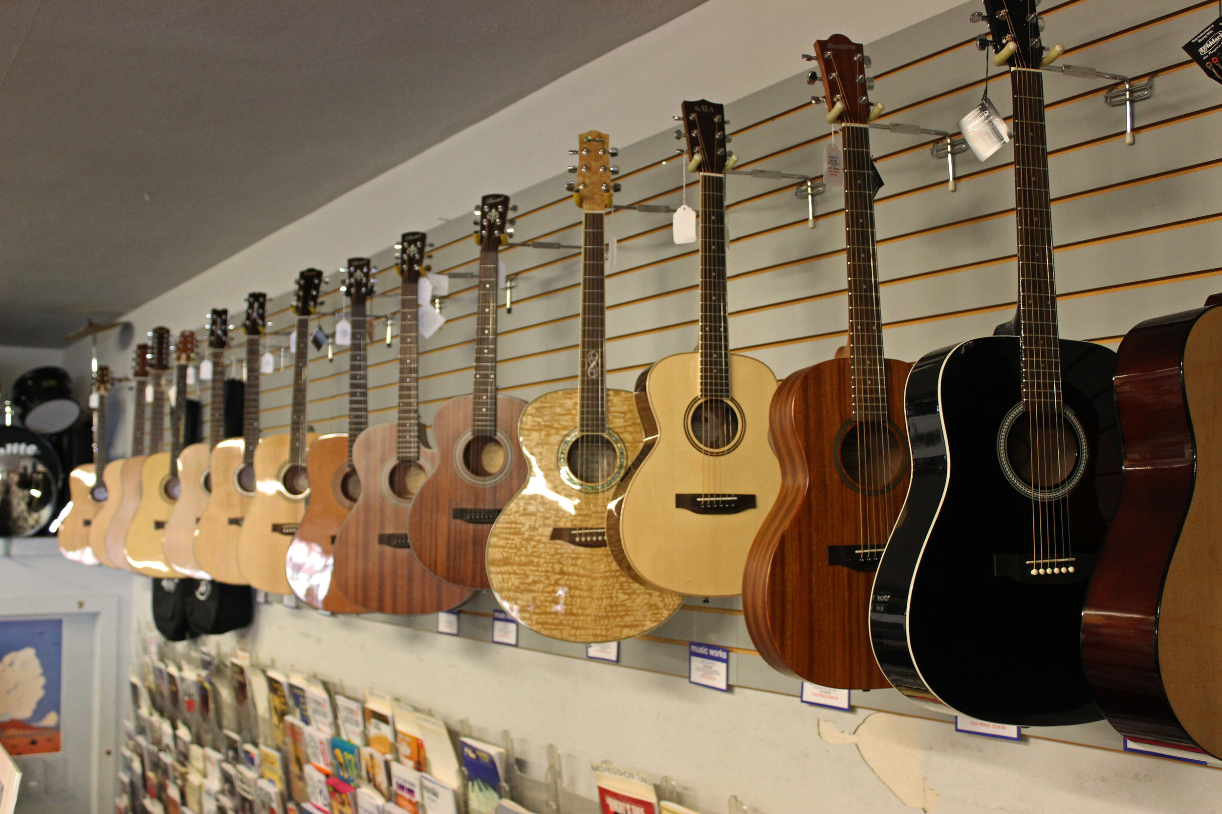 Acoustic guitars  Our far wall is lined with Parlor, Orchestra, Grand Concert and many Dreadnaught sized acoustics.