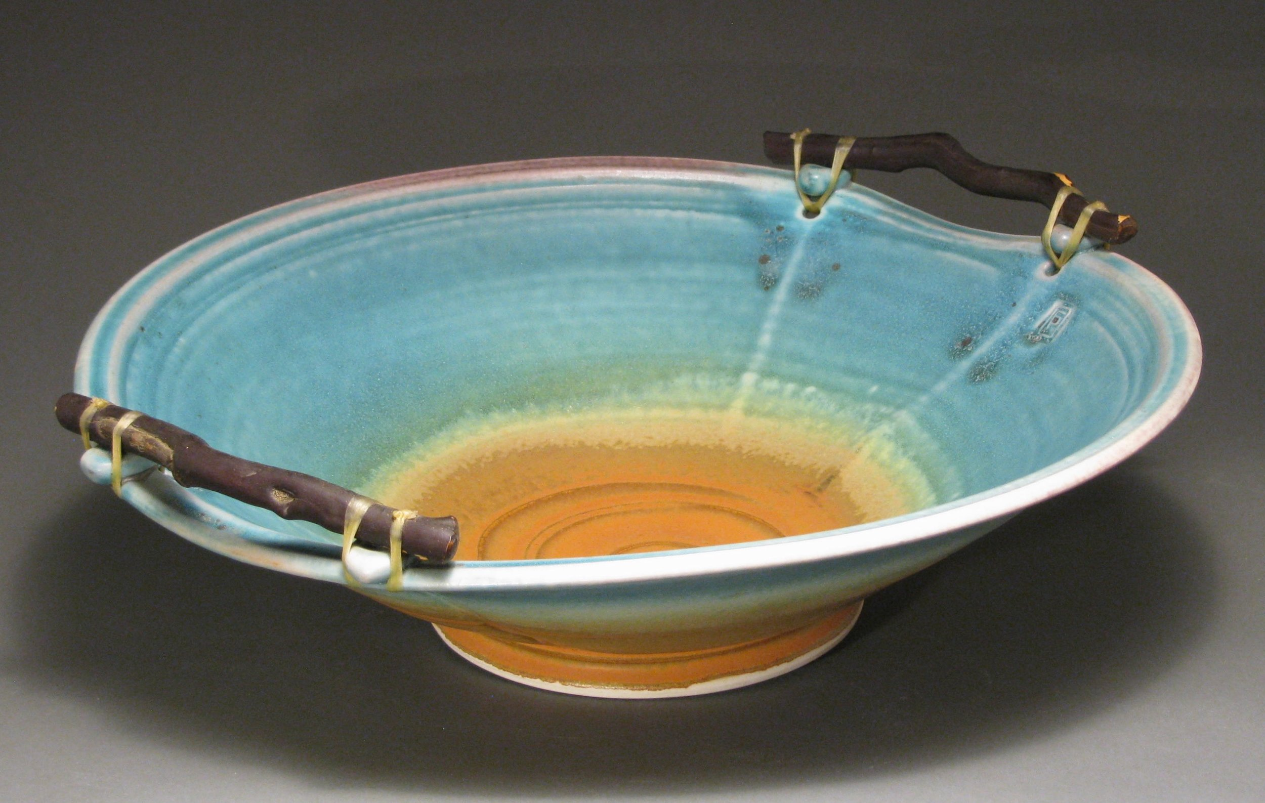 Manzanita handled bowl with matte turquoise and rust glazes