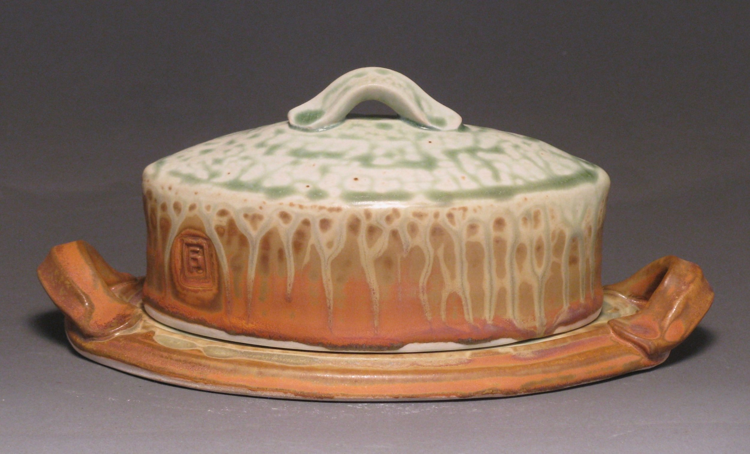 Oval butter dish  Glazes: green ash and matte rust