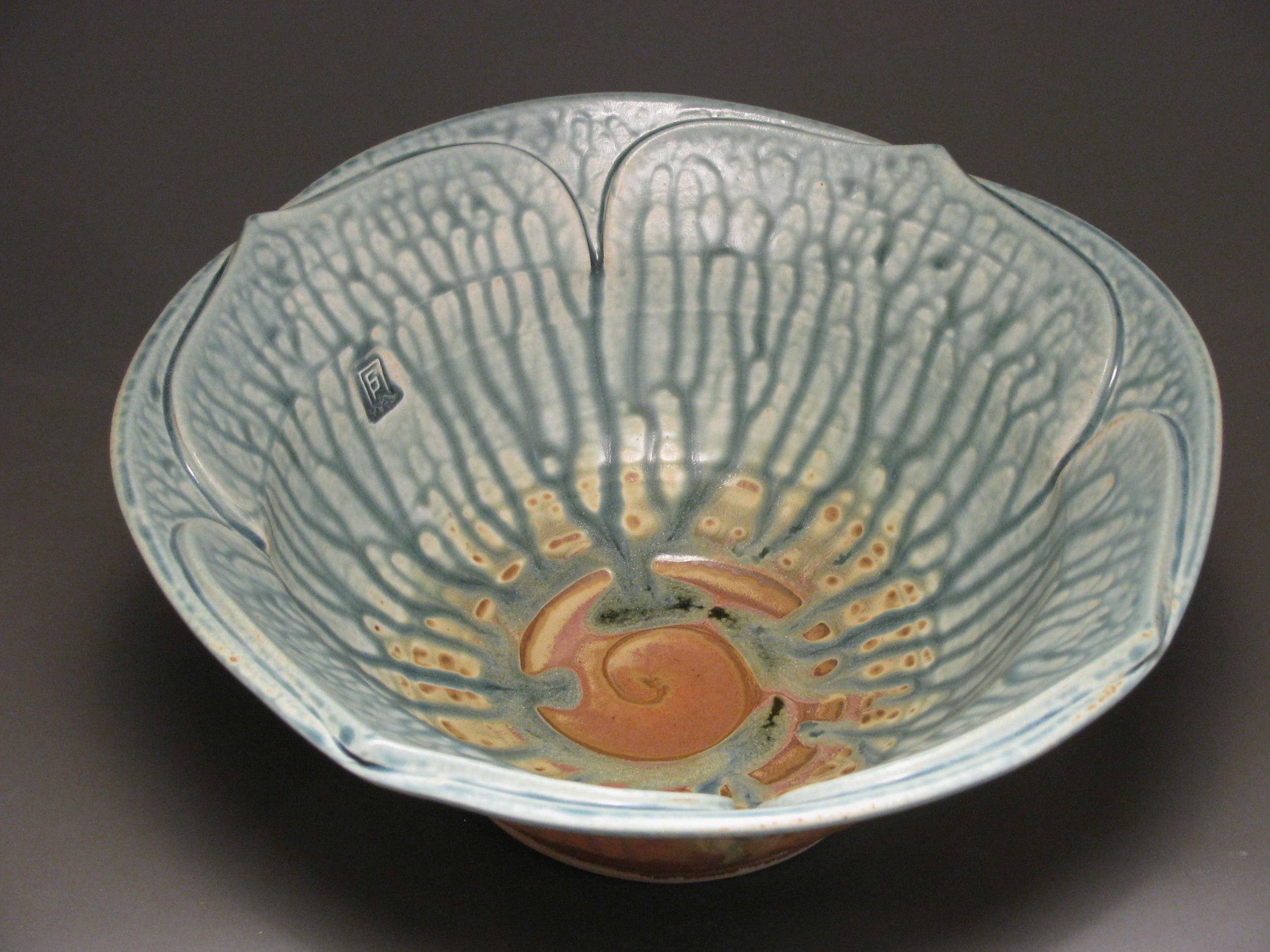 Lotus serving bowl  Glazes: blue ash and matte rust