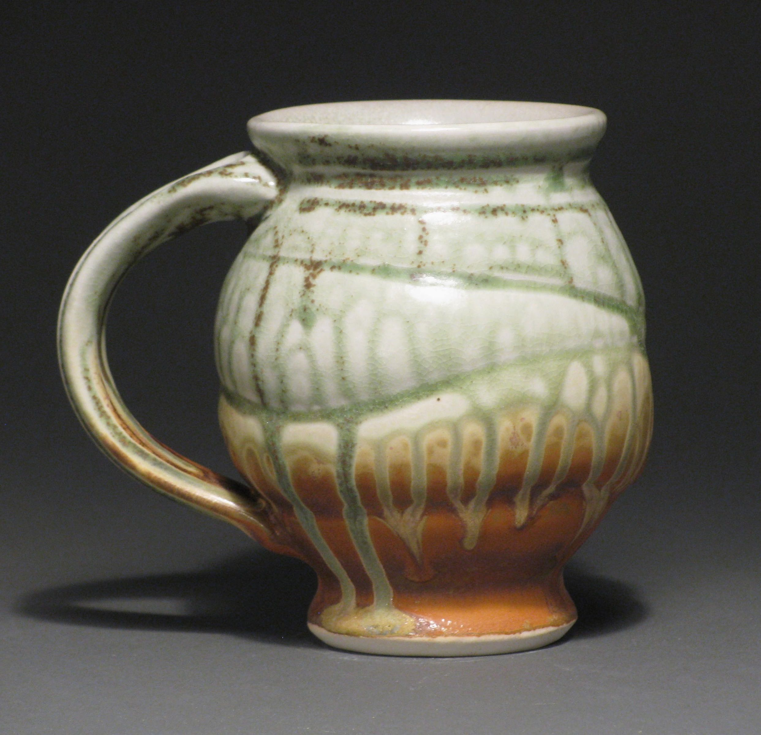 "Round bellied mug  5"" tall  Glazes: green ash and matte rust"