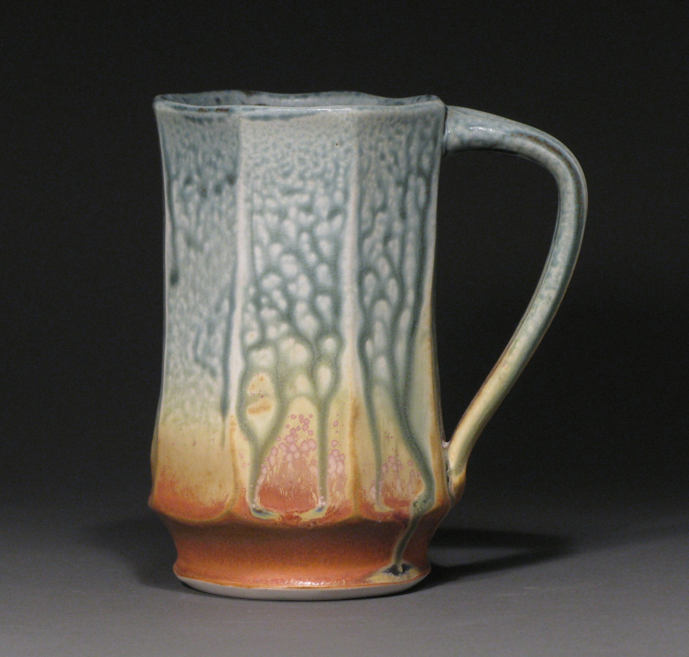 "Facetted mug  5.5"" tall  Glazes: blue ash and matte rust"