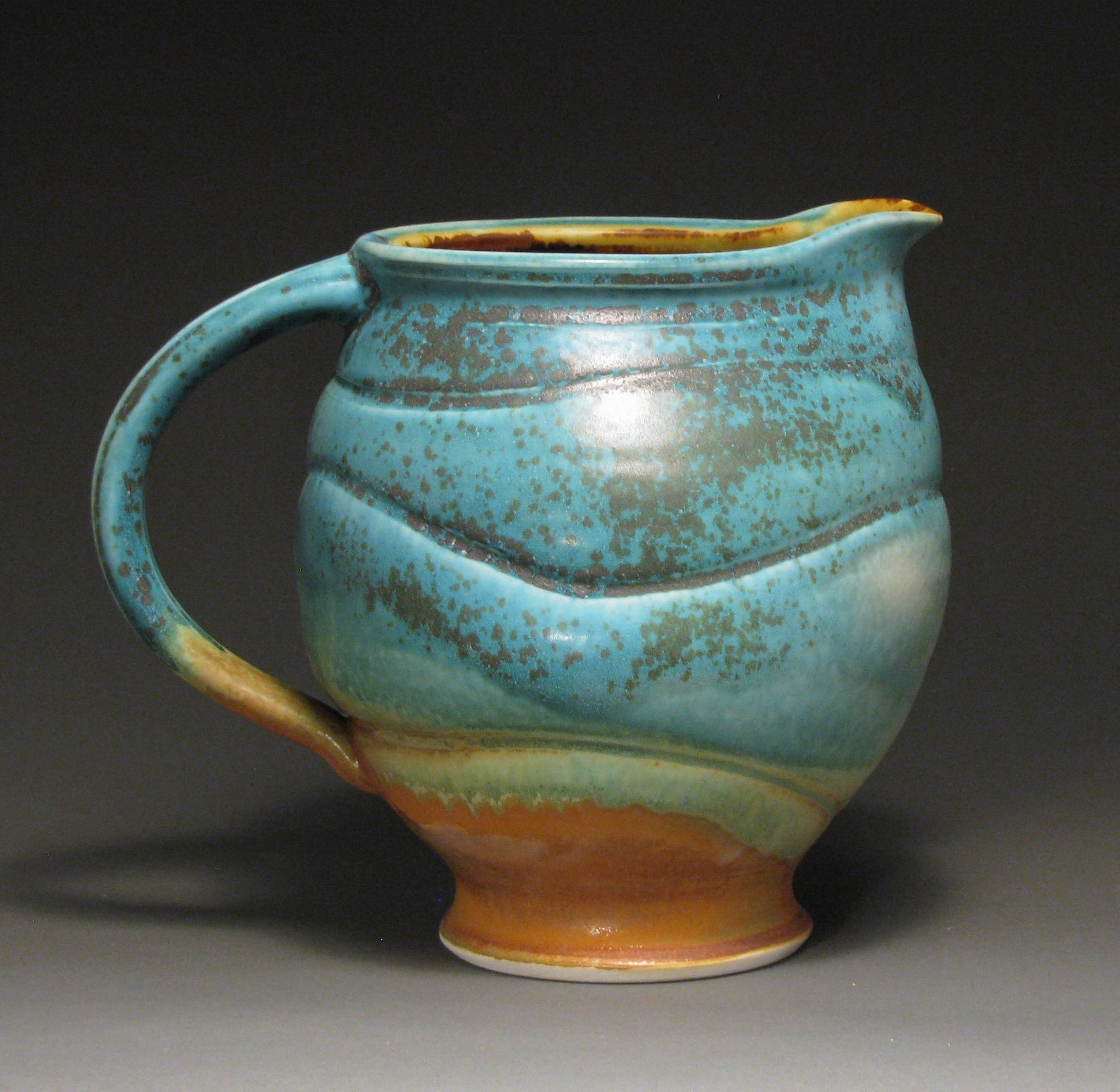 "Pitcher  9"" tall  Glazes: matte turquoise and matte rust"