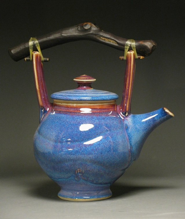 "Teapot  10.5"" tall  Glazes: purple haze and copper red"