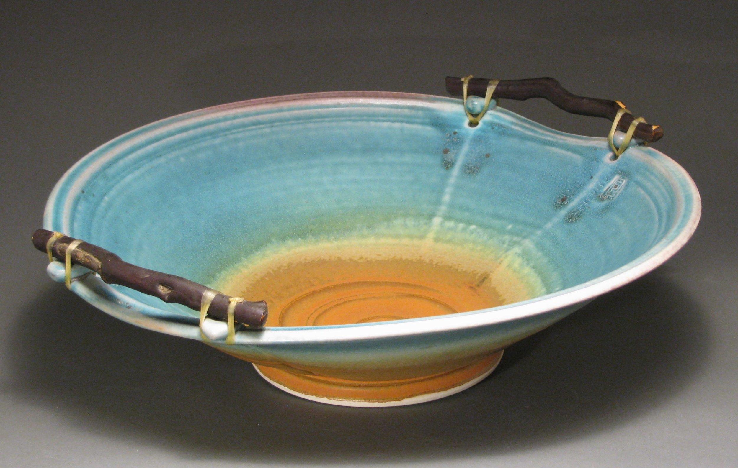 "Manzanita handled bowl  15"" diameter  Glazes: matte turquoise and matte rust"