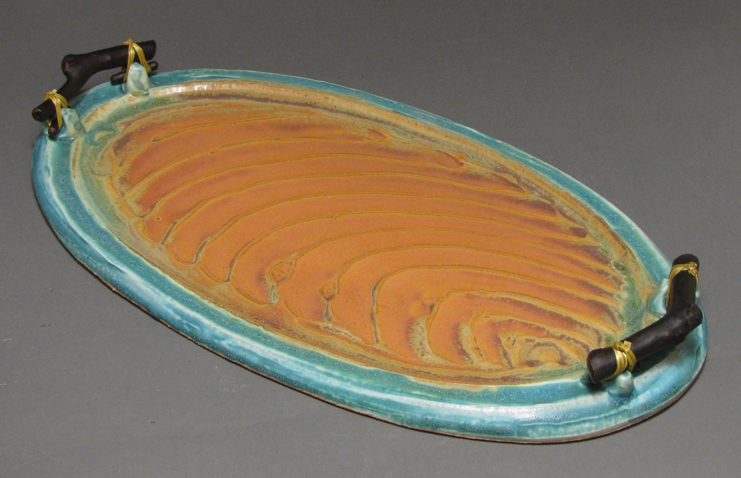 "Tray with manzanita handles  17.5"" long  Glazes: Matte turquoise and matte rust"
