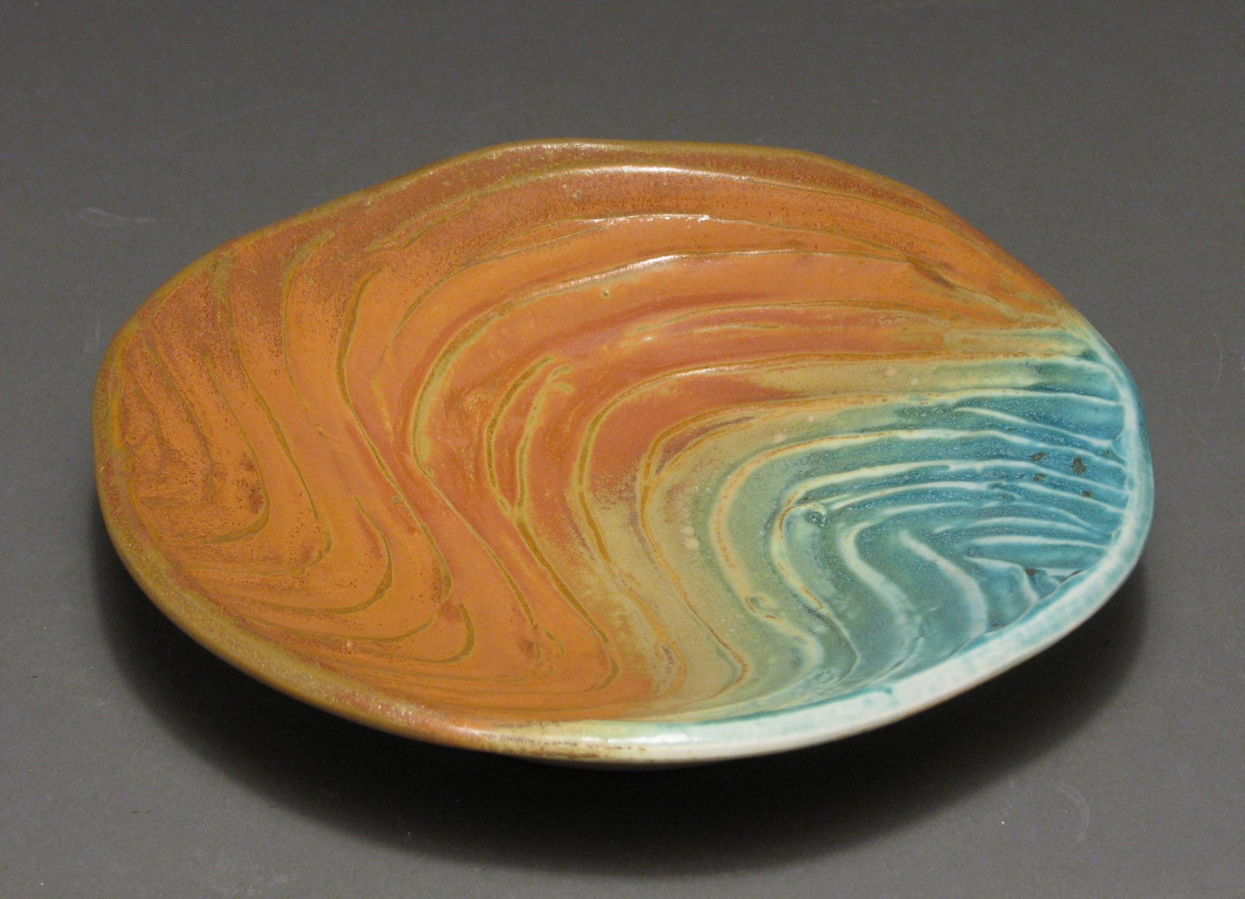 "Plate  8.25"" diameter by 1.75"" tall (size can be varied according to customer preference)  Glazes: matte turquoise and matte rust (this design also works well with the ash glazes)"