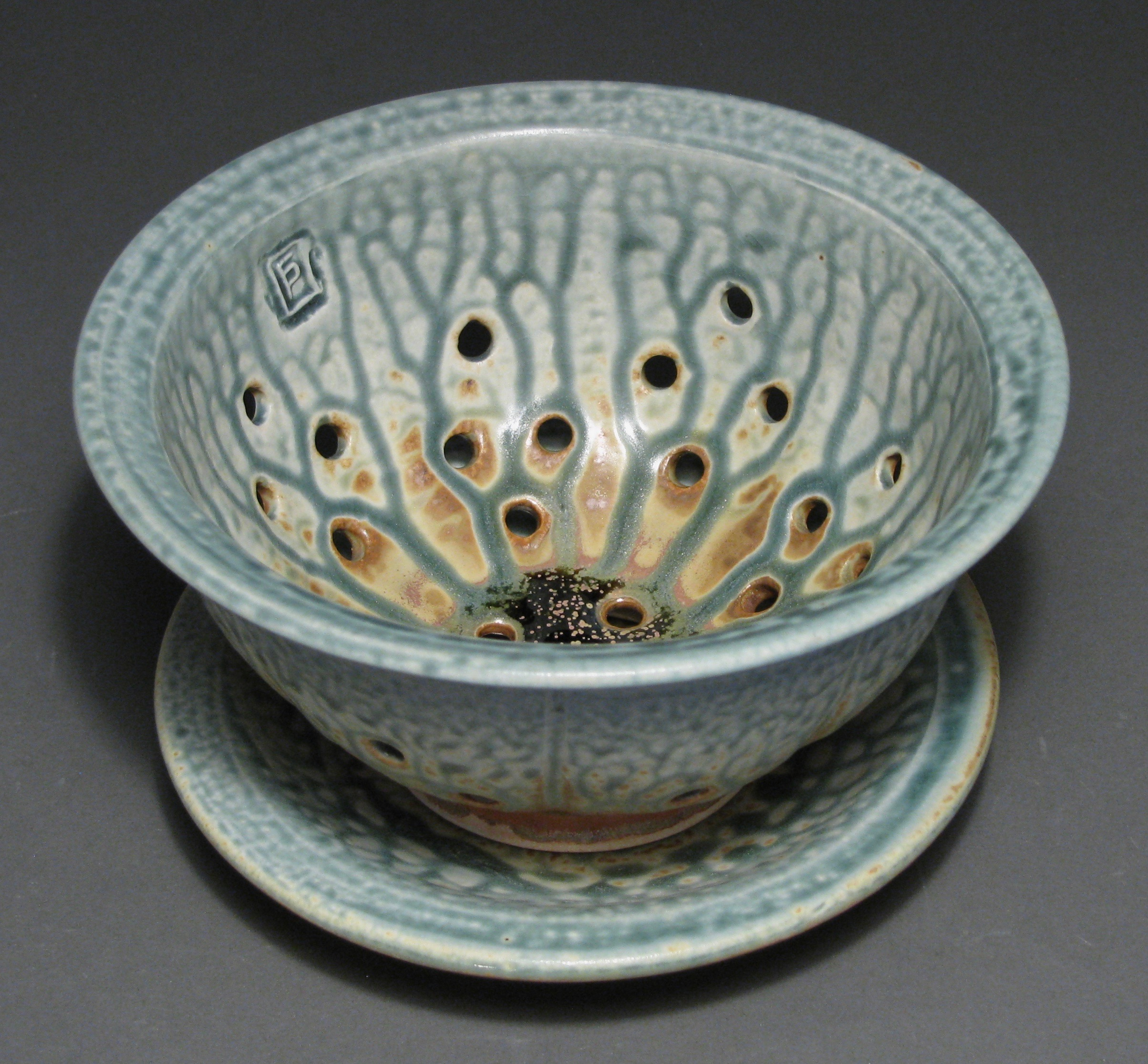 "Berry bowl  7"" diameter  Glazes: blue ash and matte rust"