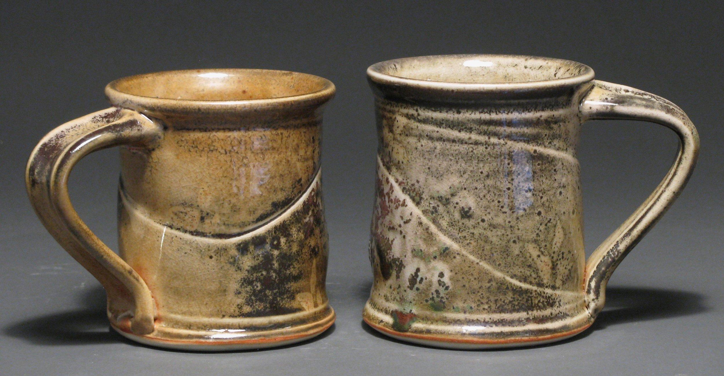 """Cylindrical mugs  4"""" tall  Glaze: Davis shino"""