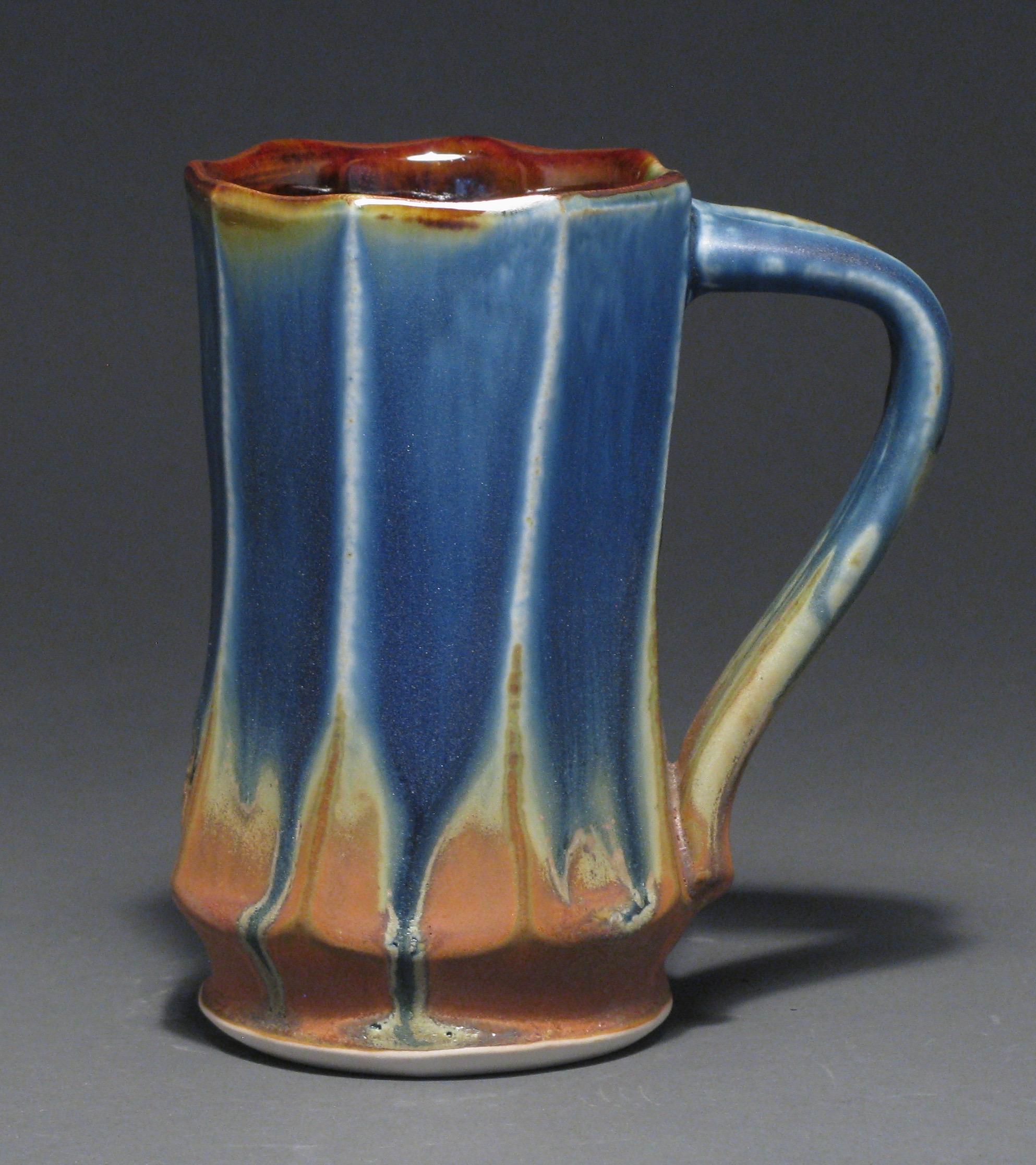 "Facetted mug  5.5"" tall  Glazes: matte blue and matte rust"