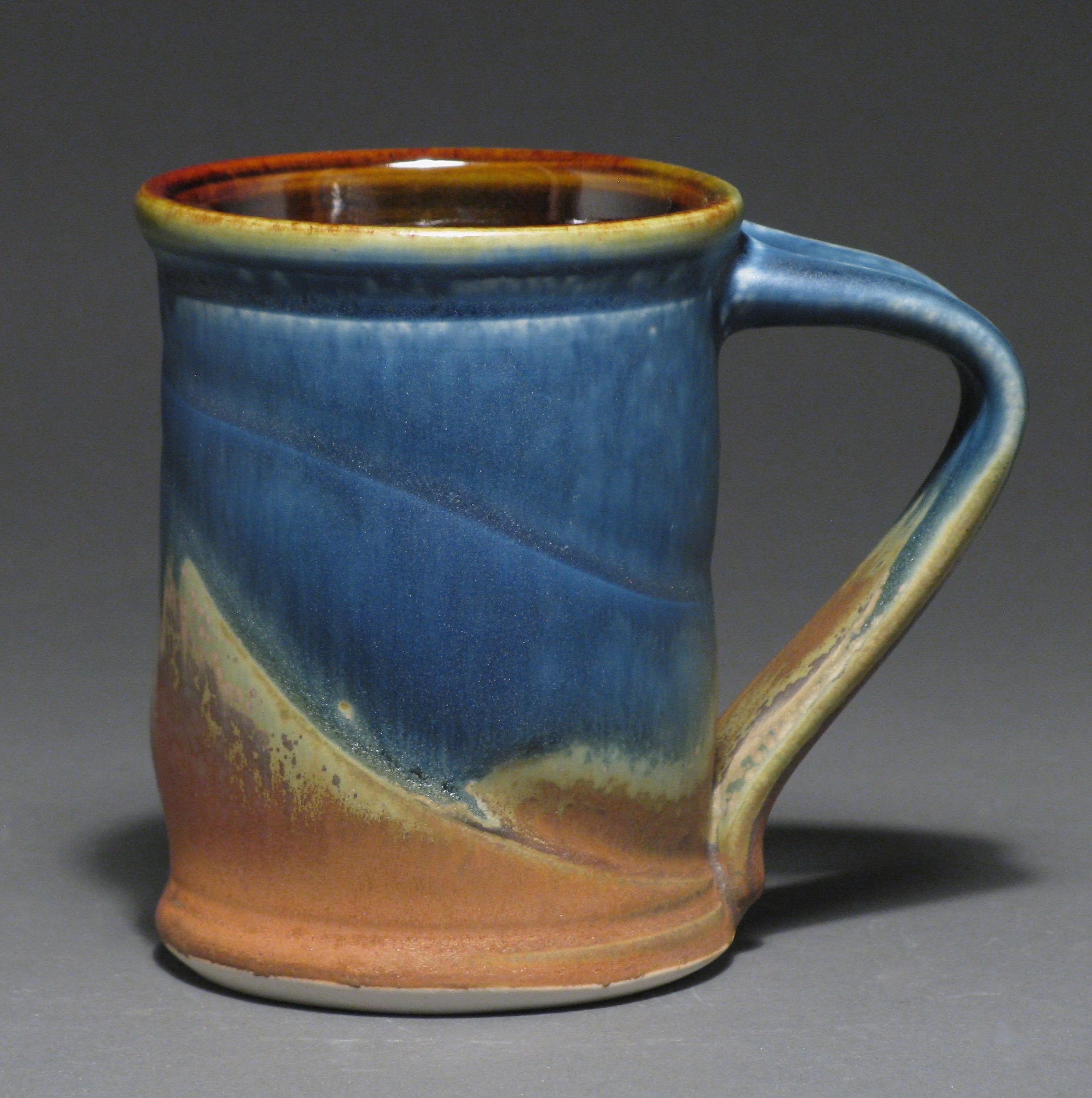 "Cylindrical mug  4.5"" tall  Glazes: Matte blue and matte rust"