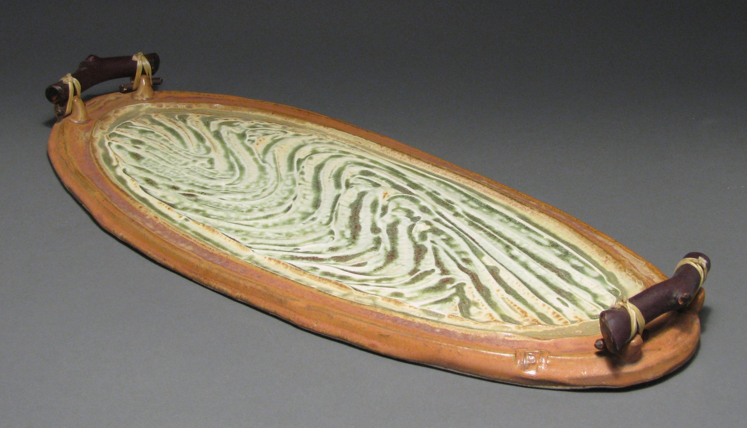 "Serving tray with manzanita handles and textured surface  18"" long  Glazes: green ash and matte rust"