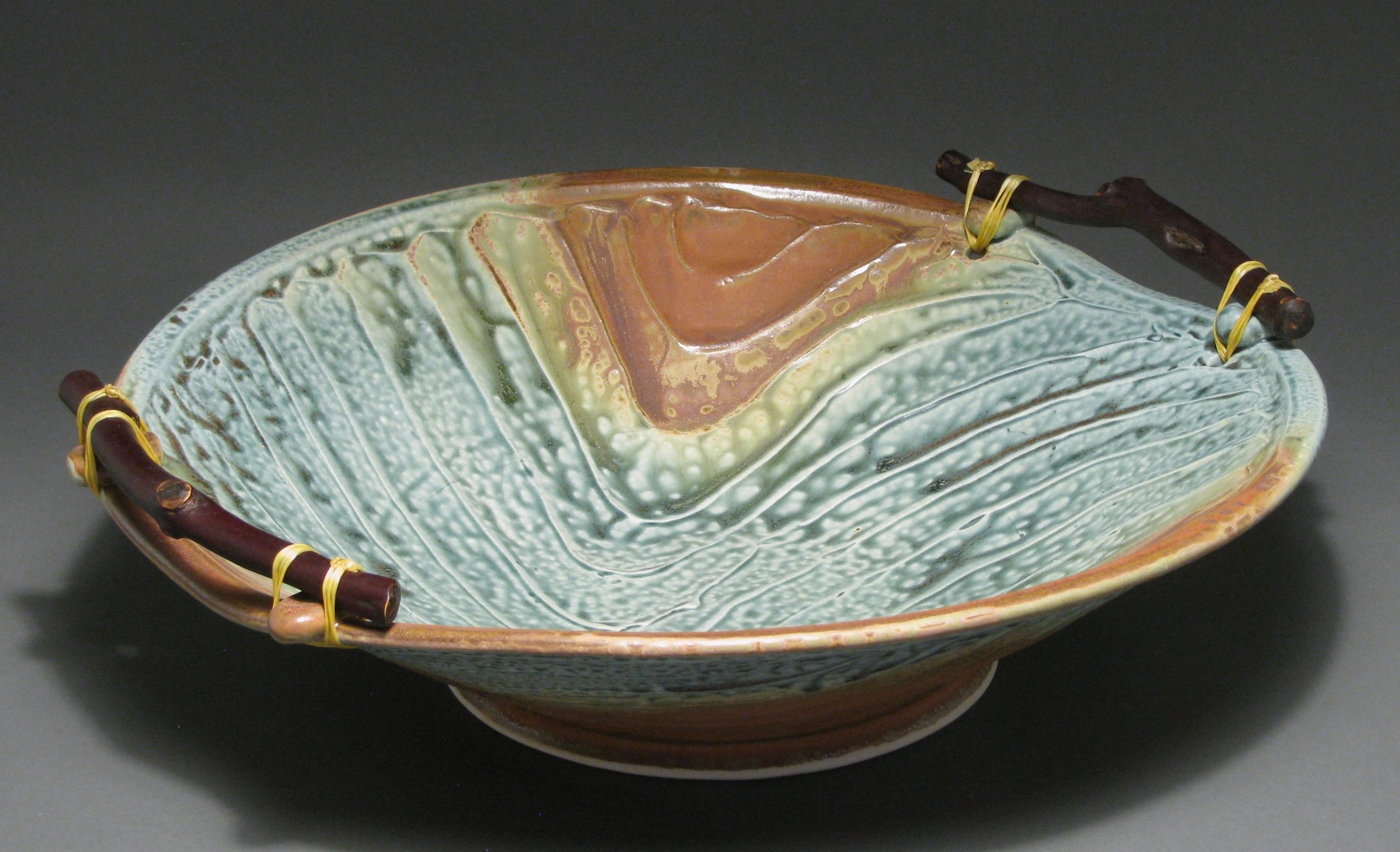 "Manzanita handled bowl  16"" diameter  Glazes: blue ash and matte rust"