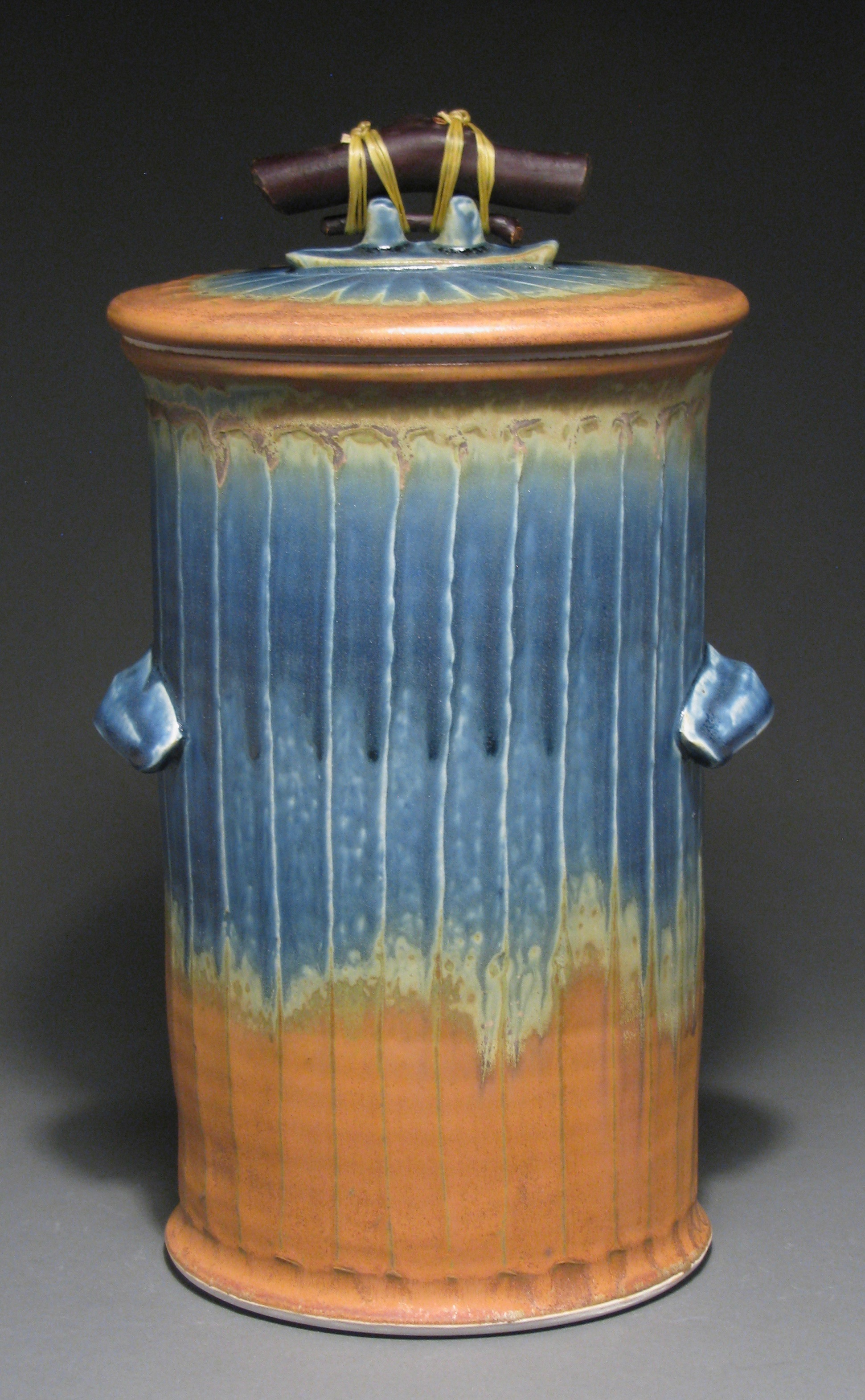 "Fermentation jar with weight  14"" tall  Glazes: Mixed blue and matte rust"